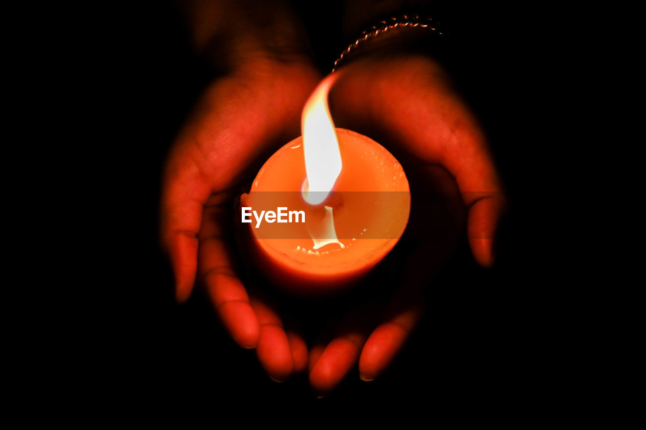 human hand, hand, flame, burning, fire, illuminated, heat - temperature, human body part, close-up, one person, indoors, dark, candle, glowing, holding, human finger, fire - natural phenomenon, finger, body part, real people, black background