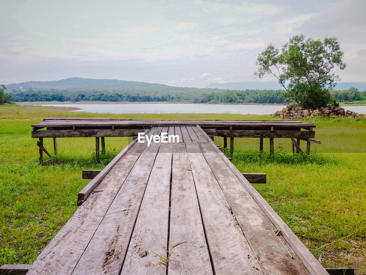 plant, grass, wood - material, bench, sky, tree, nature, scenics - nature, mountain, day, tranquility, seat, no people, empty, land, beauty in nature, field, picnic table, table, landscape, outdoors, park bench