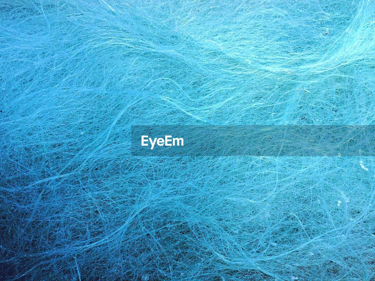Full Frame Shot Of Blue Tangled Thread