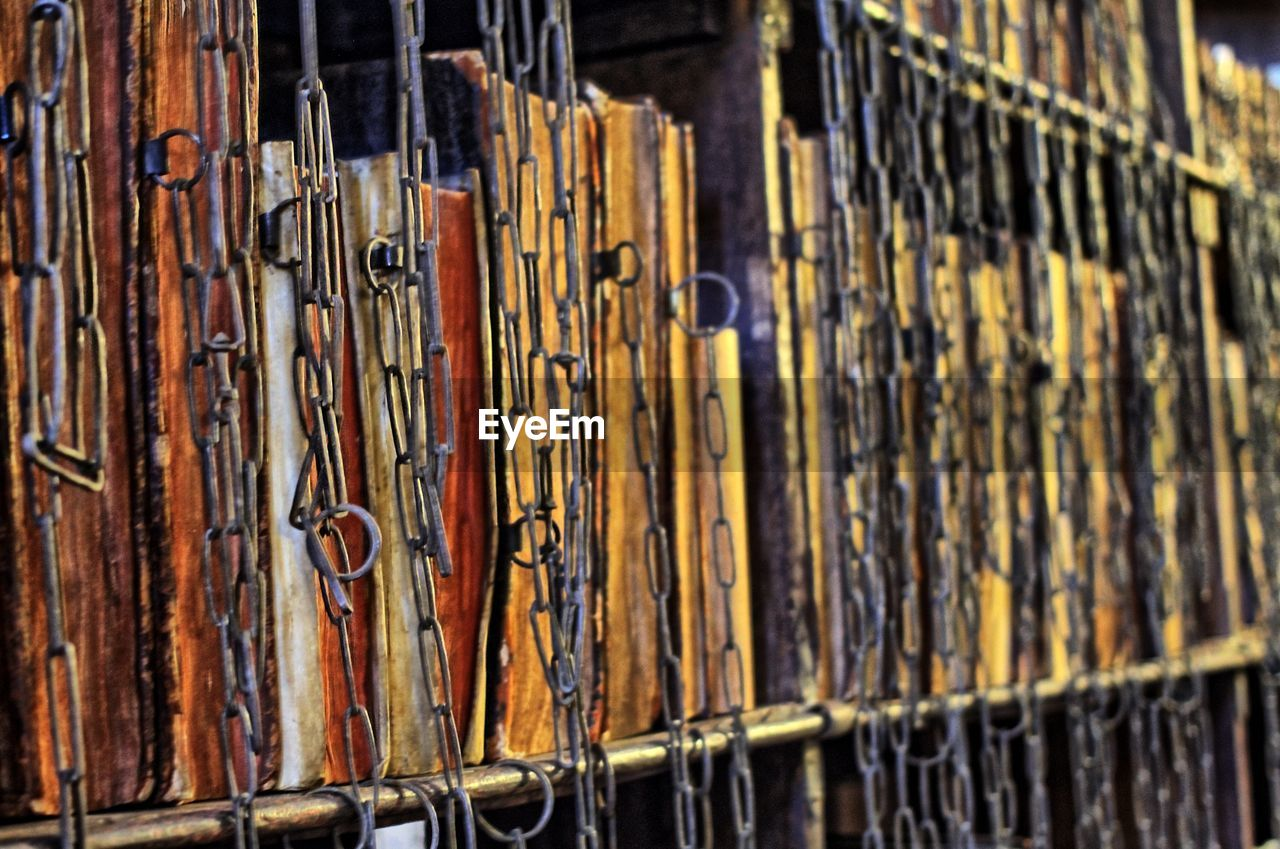 Full frame shot of old books in shelf at library