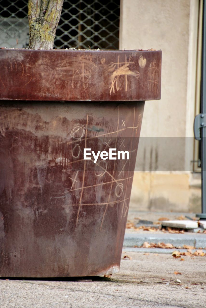 no people, rusty, day, focus on foreground, architecture, metal, close-up, built structure, outdoors, text, old, western script, abandoned, dirt, nature, weathered, bad condition, obsolete, run-down, hopelessness