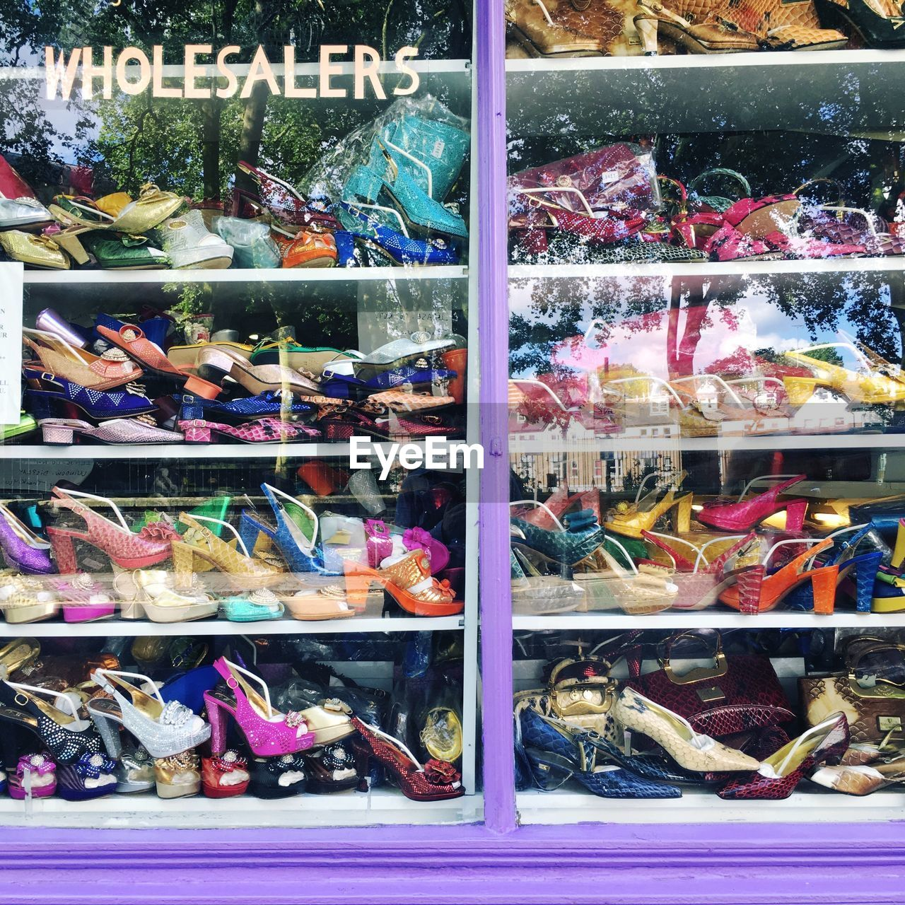 multi colored, choice, variation, retail, for sale, abundance, large group of objects, shoe, no people, indoors, shelf, market, day