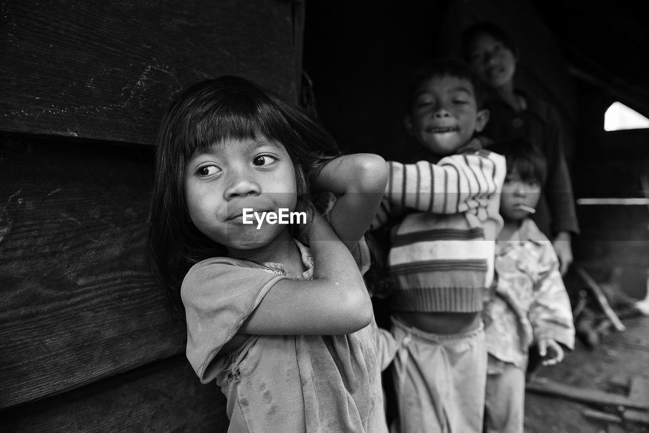 Poor children standing on street