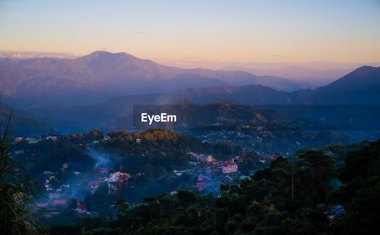 mountain, sky, scenics - nature, beauty in nature, sunset, tranquil scene, mountain range, tranquility, environment, no people, nature, landscape, tree, idyllic, plant, non-urban scene, architecture, fog, building exterior, outdoors