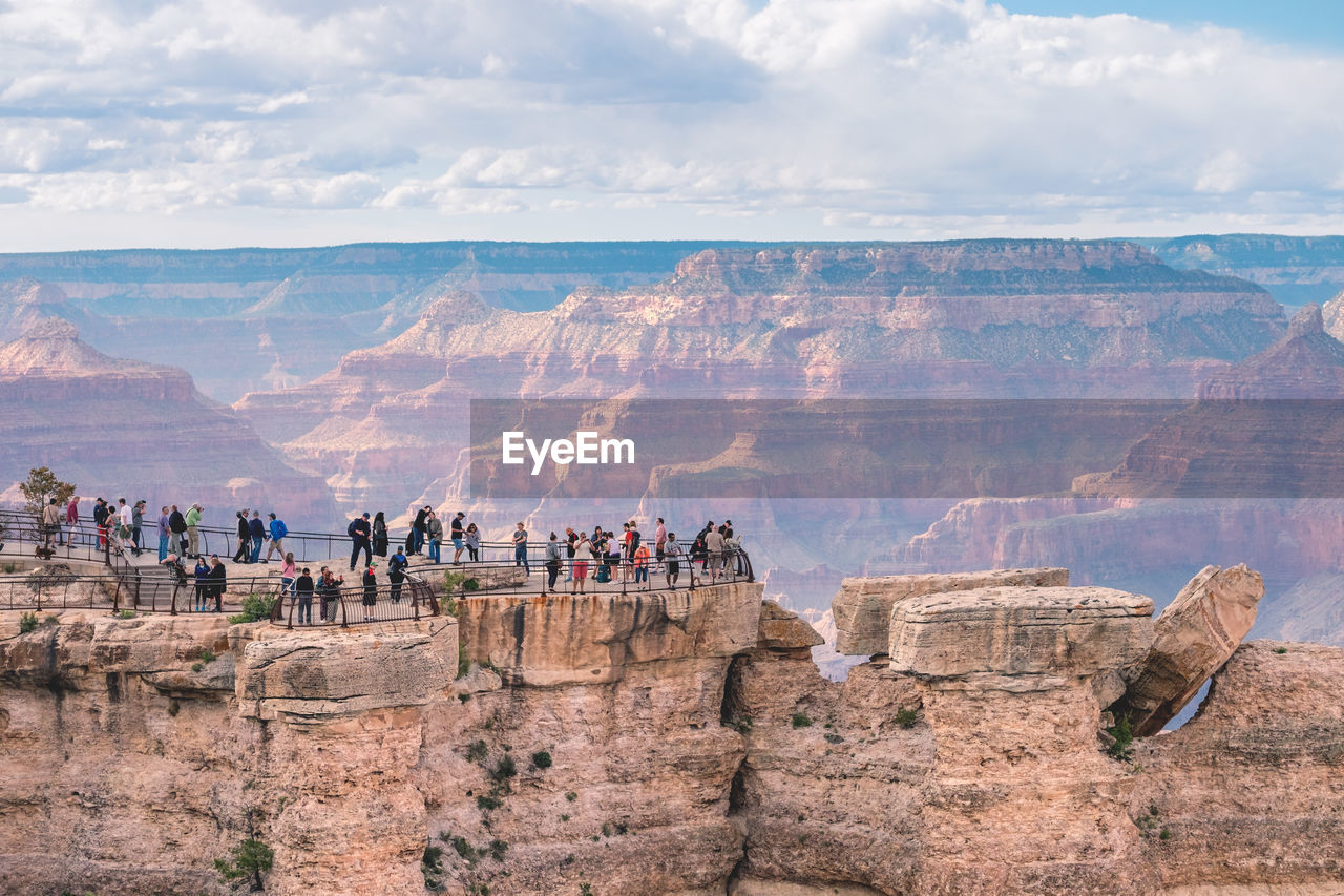People On Cliff At Grand Canyon
