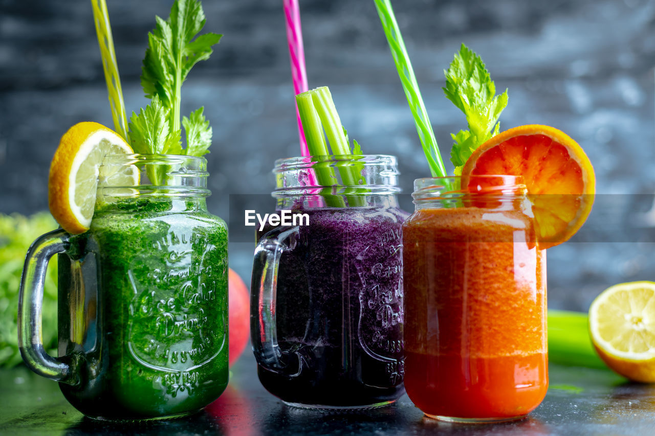 food and drink, food, freshness, container, fruit, healthy eating, drink, jar, citrus fruit, glass - material, still life, wellbeing, refreshment, vegetable, drinking straw, smoothie, straw, green color, no people, glass, herb, orange, mint leaf - culinary