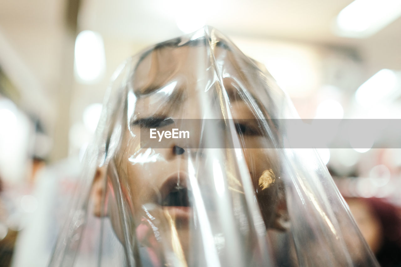 Close-Up Of Boy Face Covered With Plastic