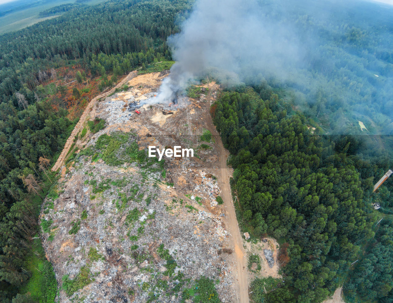 Aerial View Of Smoke Emitting From Mountain