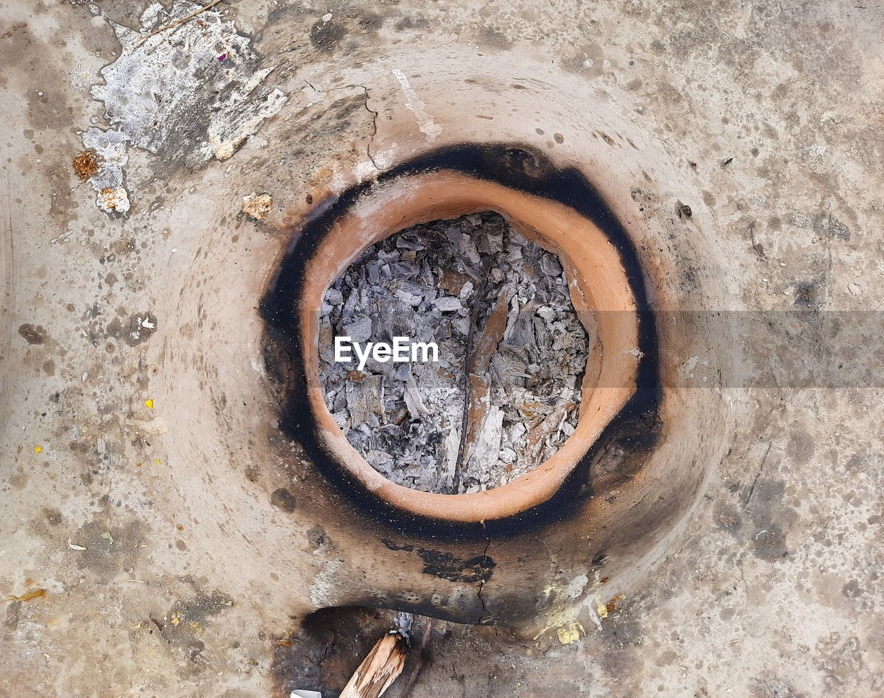 HIGH ANGLE VIEW OF OLD HOLE ON METAL