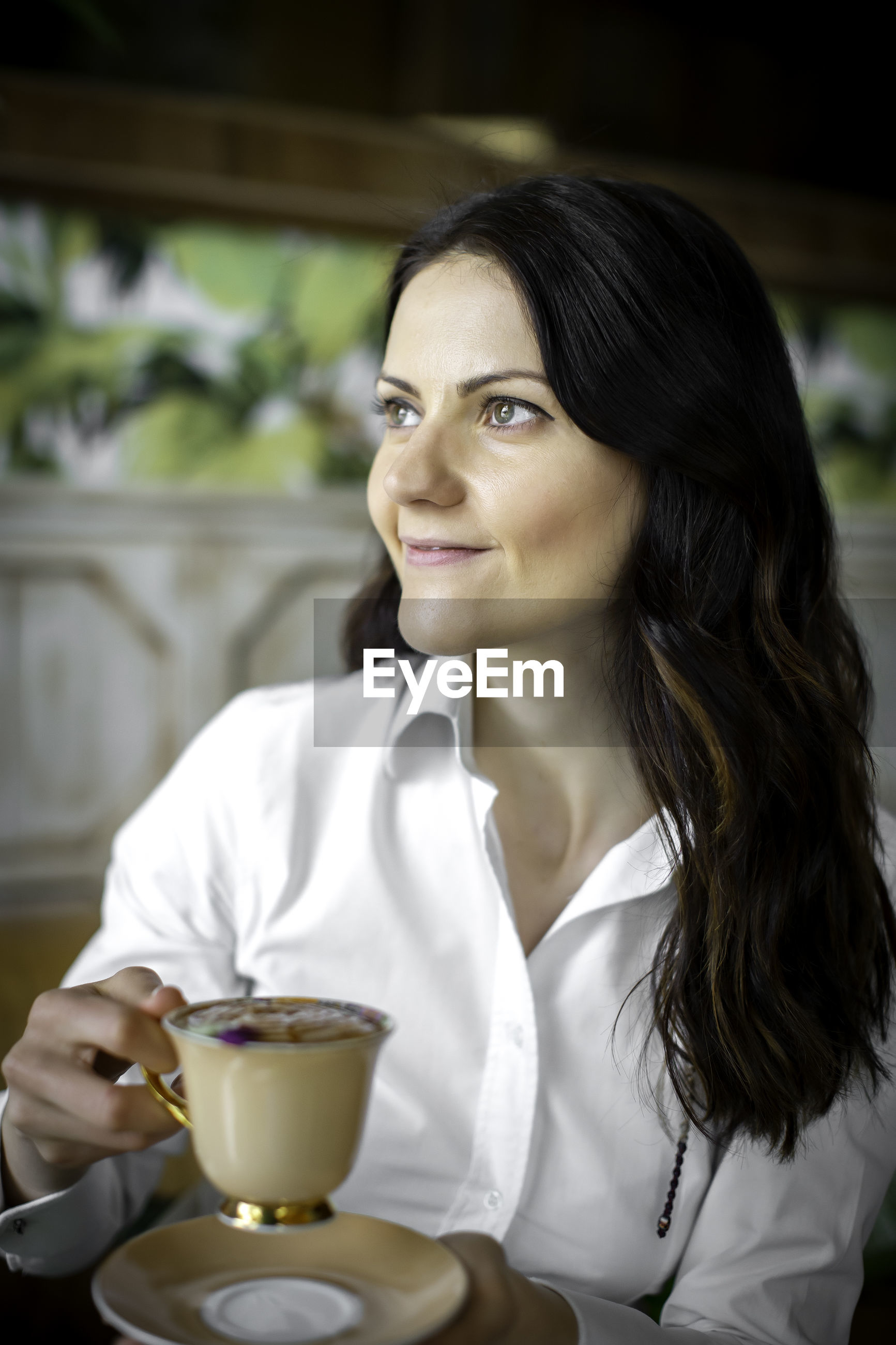 Smiling woman with coffee at home