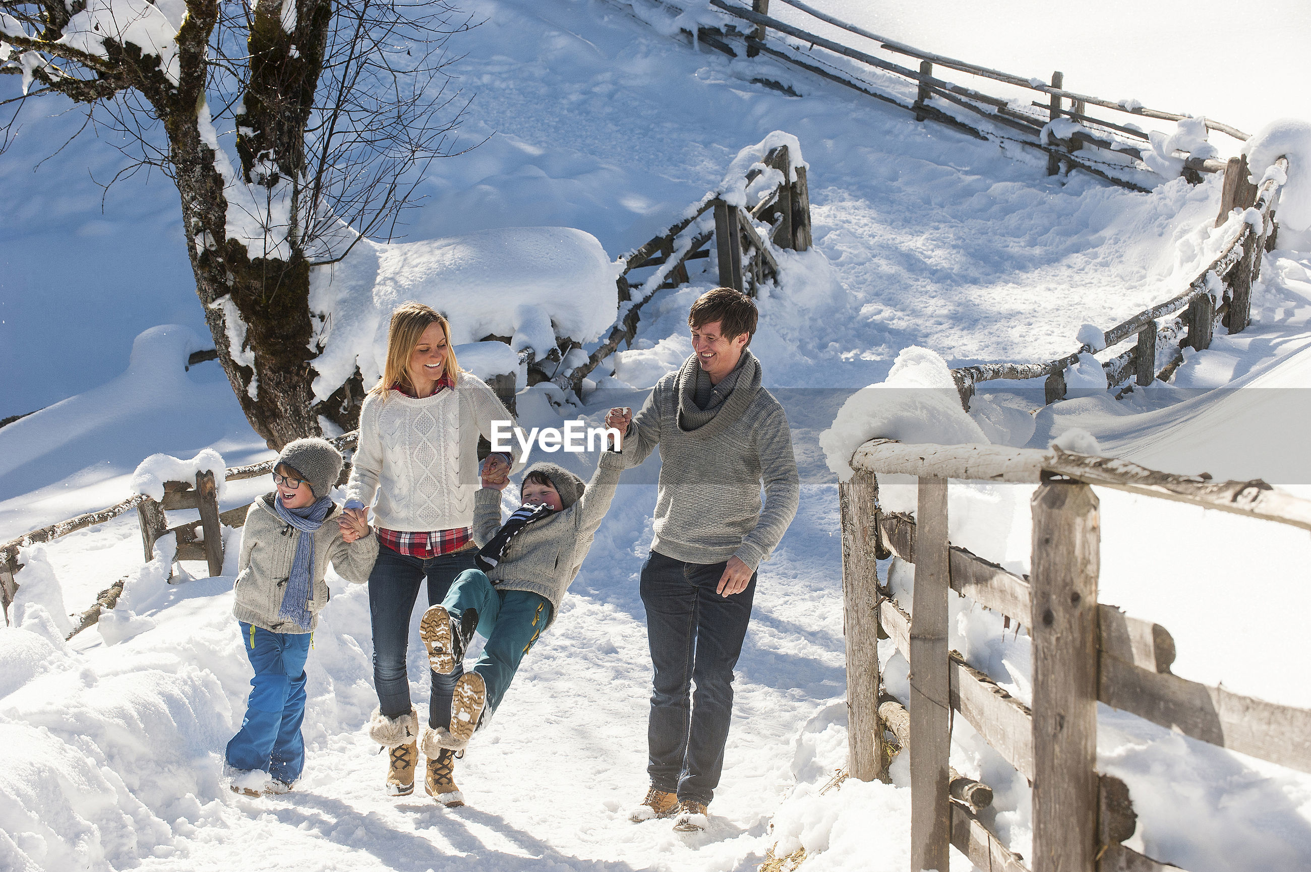 GROUP OF PEOPLE ON SNOW