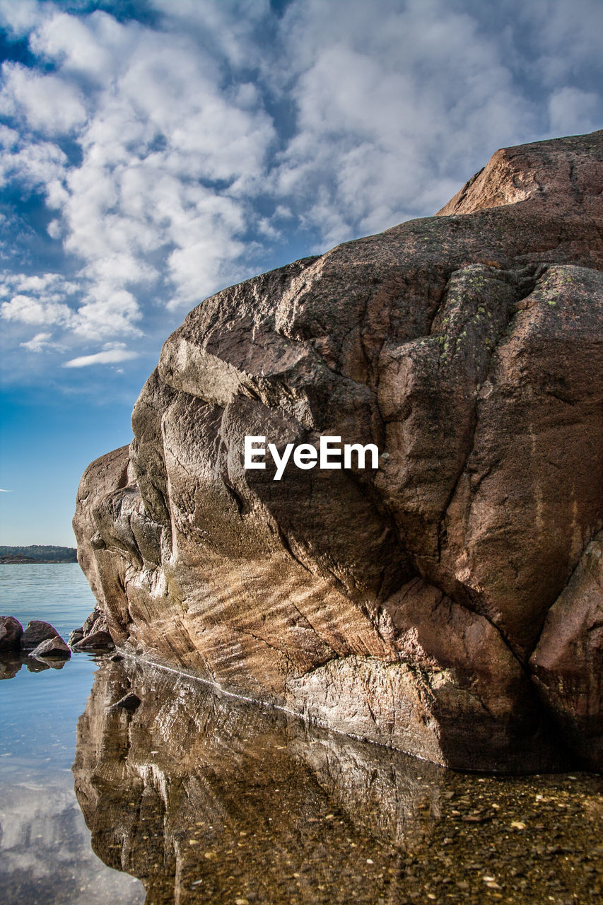 rock - object, sky, cloud - sky, rock formation, nature, rock, tranquility, day, outdoors, beauty in nature, rough, no people, tranquil scene, scenics, physical geography, cliff, water, tree, close-up