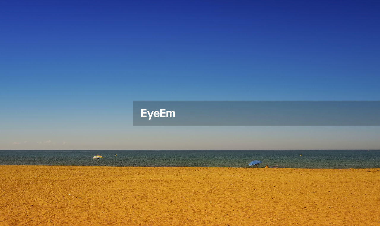 sky, sea, water, horizon over water, scenics - nature, horizon, land, beauty in nature, clear sky, copy space, tranquility, blue, tranquil scene, beach, nature, idyllic, day, sand, non-urban scene, no people, outdoors