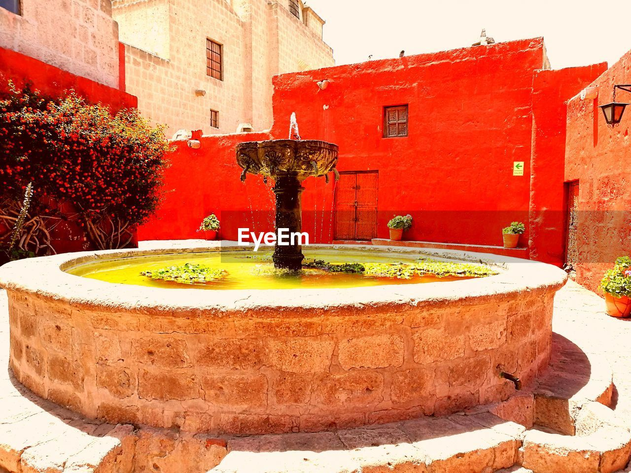 fountain, architecture, water, building exterior, built structure, red, no people, drinking fountain, day, outdoors, tree, close-up