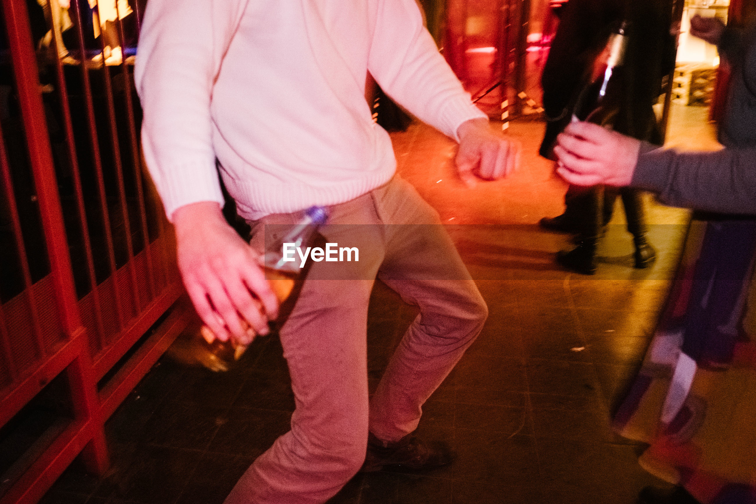 Low section of man dancing at nightclub
