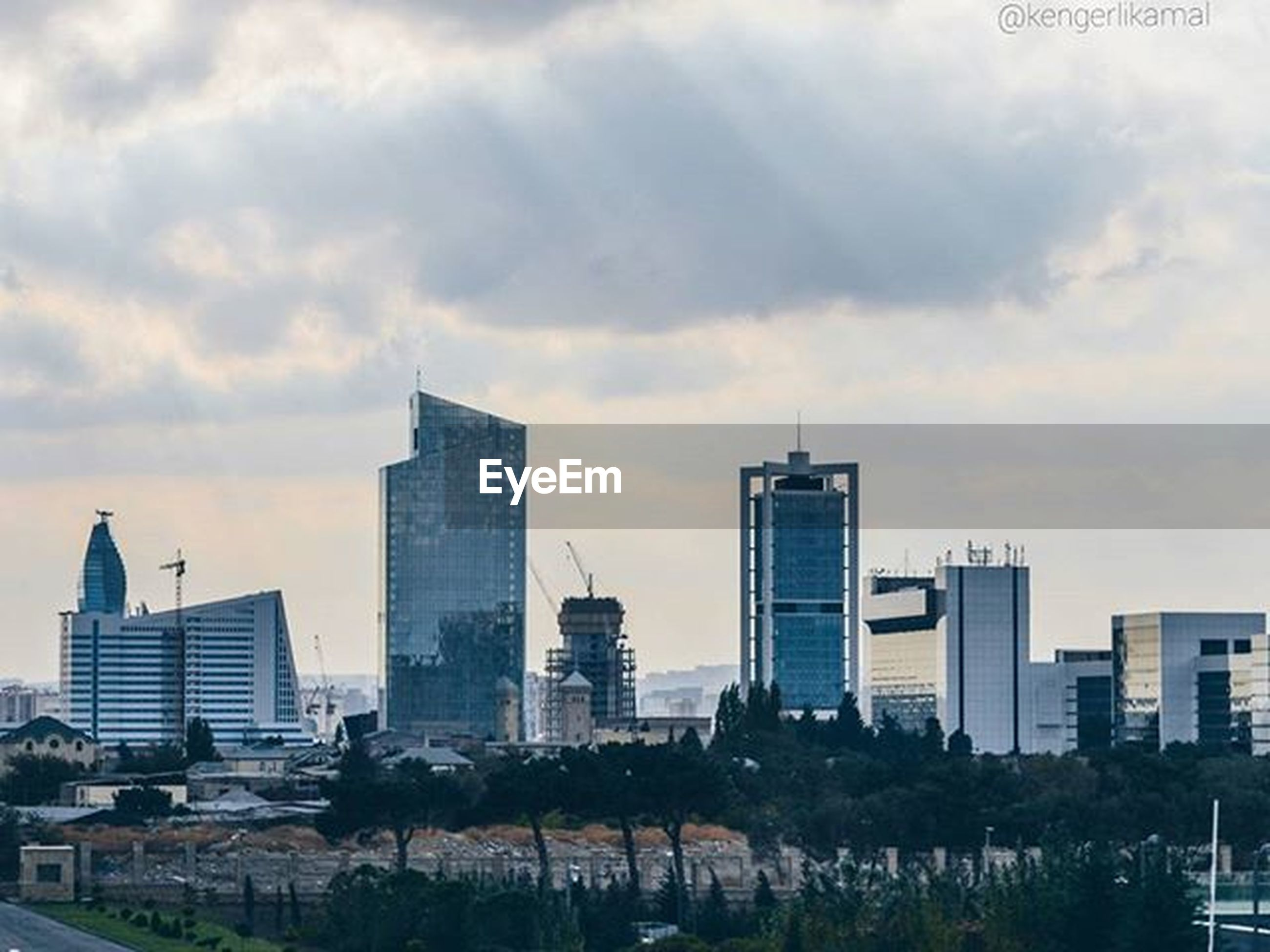 building exterior, architecture, city, skyscraper, built structure, modern, cityscape, tall - high, sky, office building, urban skyline, tower, cloud - sky, financial district, city life, building, cloudy, development, residential building, growth
