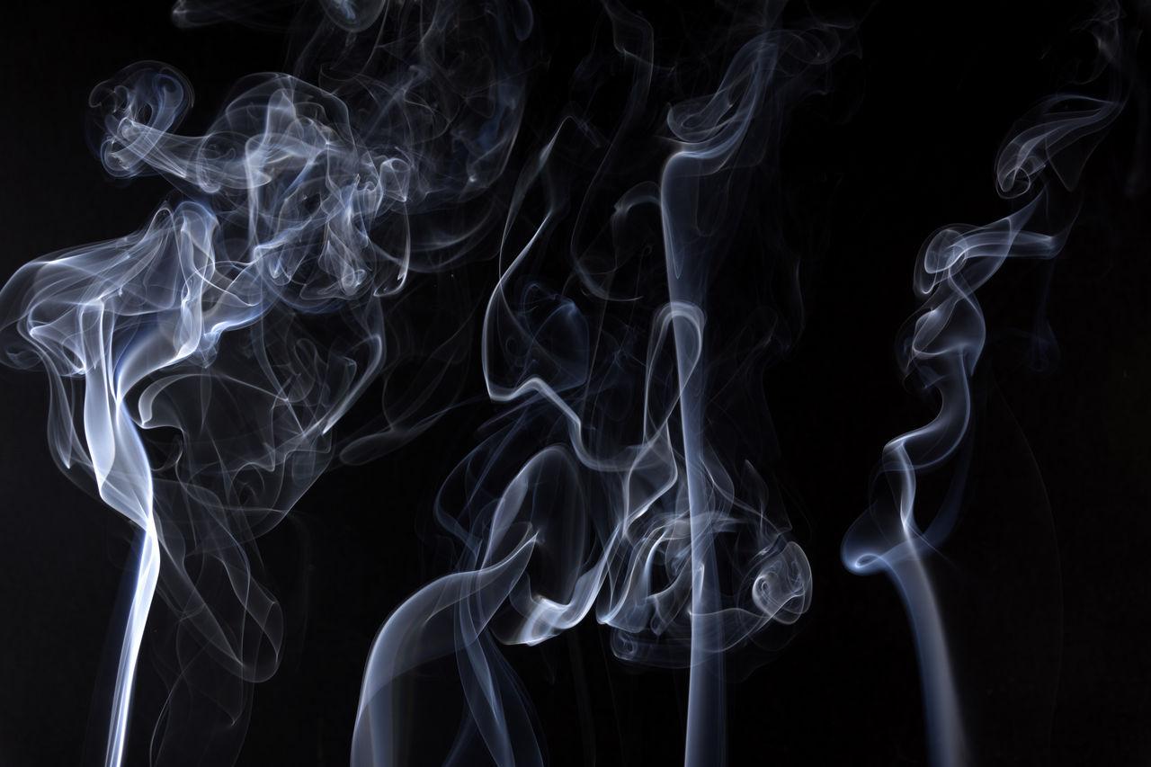 White Smoke Against Black Background