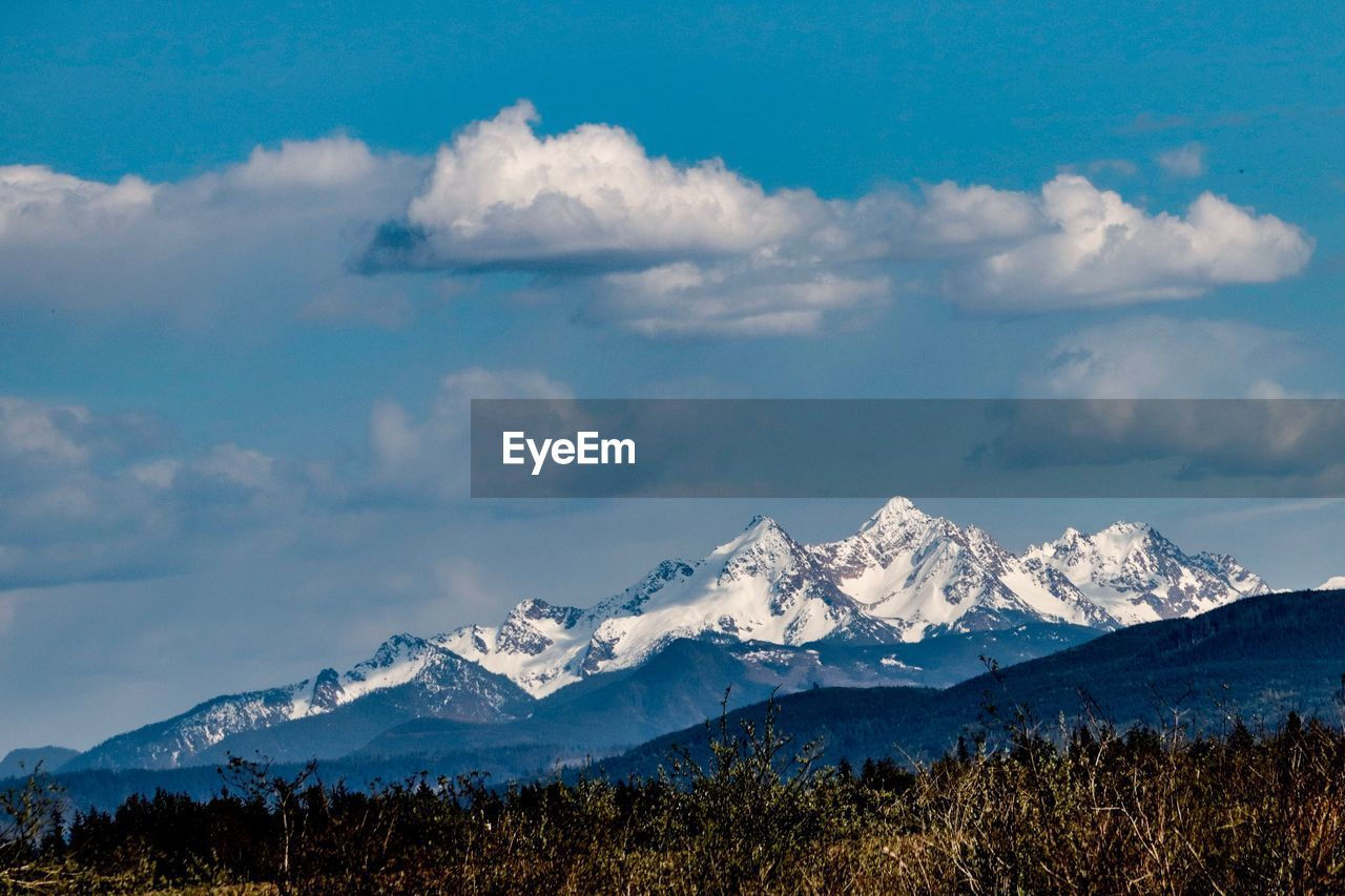 mountain, cloud - sky, sky, scenics - nature, beauty in nature, snow, mountain range, cold temperature, tranquil scene, tranquility, winter, snowcapped mountain, nature, non-urban scene, environment, day, no people, landscape, idyllic, mountain peak, outdoors, range