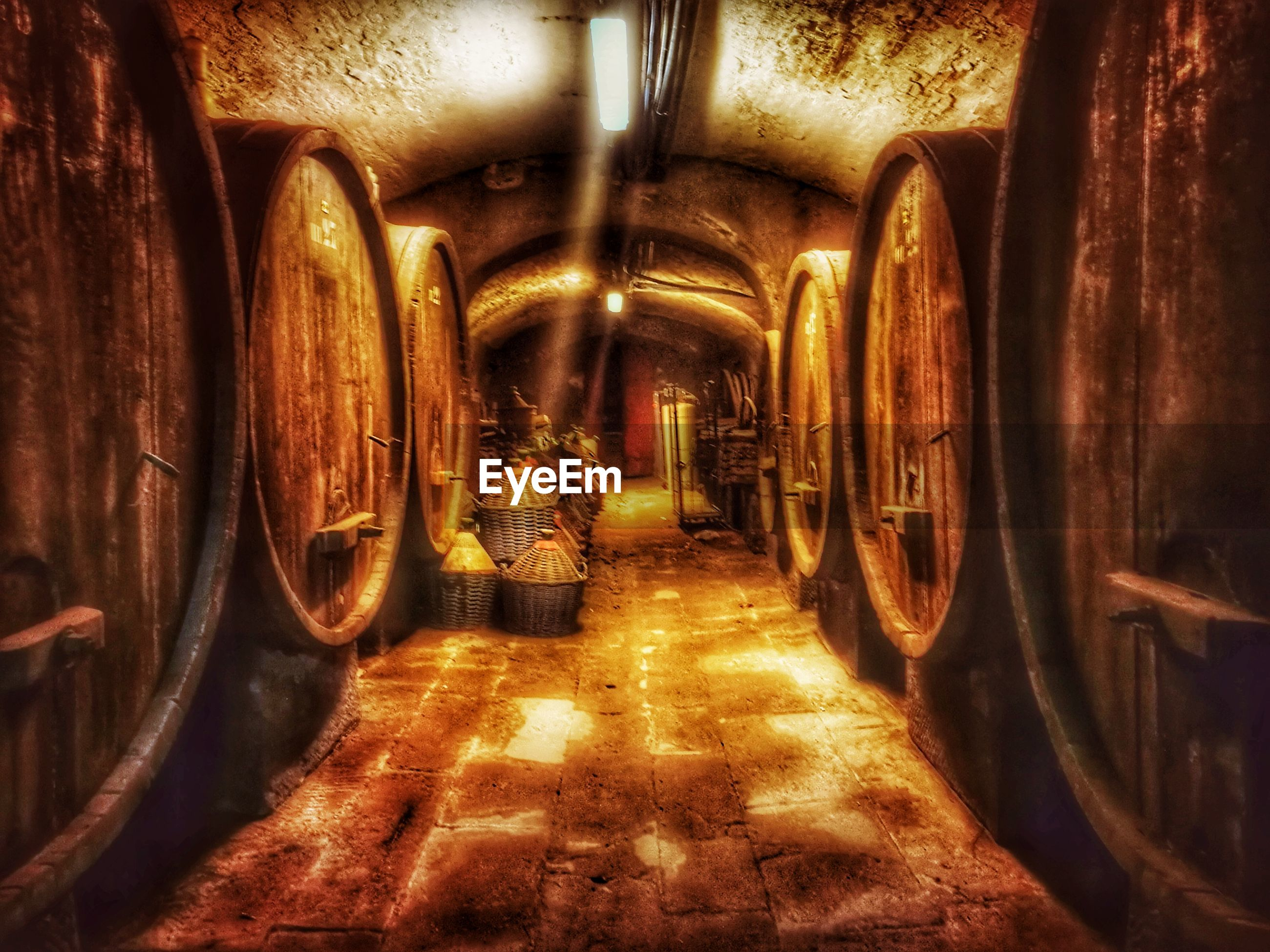 wine cask, wine cellar, winery, wine, illuminated, tunnel, indoors, barrel, cellar, winemaking, arch, no people, the way forward, alcohol, distillation, day