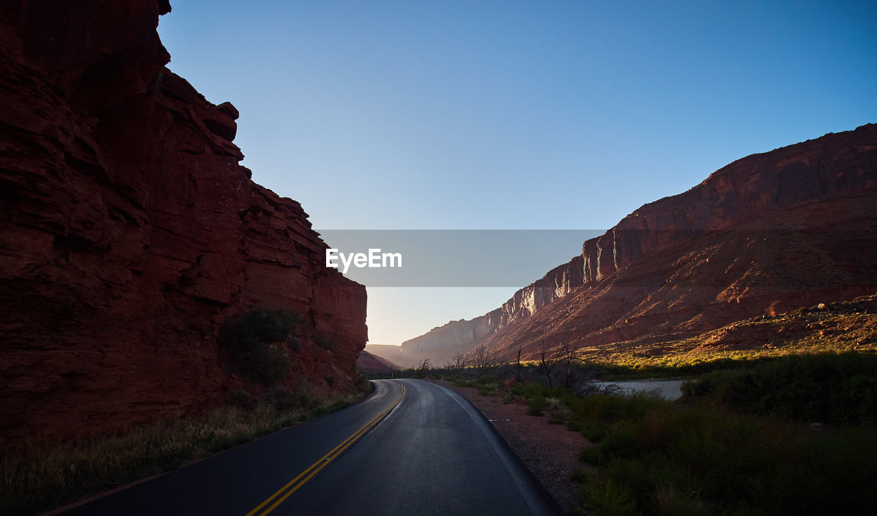 the way forward, sky, road, direction, mountain, transportation, beauty in nature, nature, scenics - nature, non-urban scene, no people, tranquil scene, diminishing perspective, rock, tranquility, day, clear sky, rock - object, rock formation, mountain range, formation, outdoors