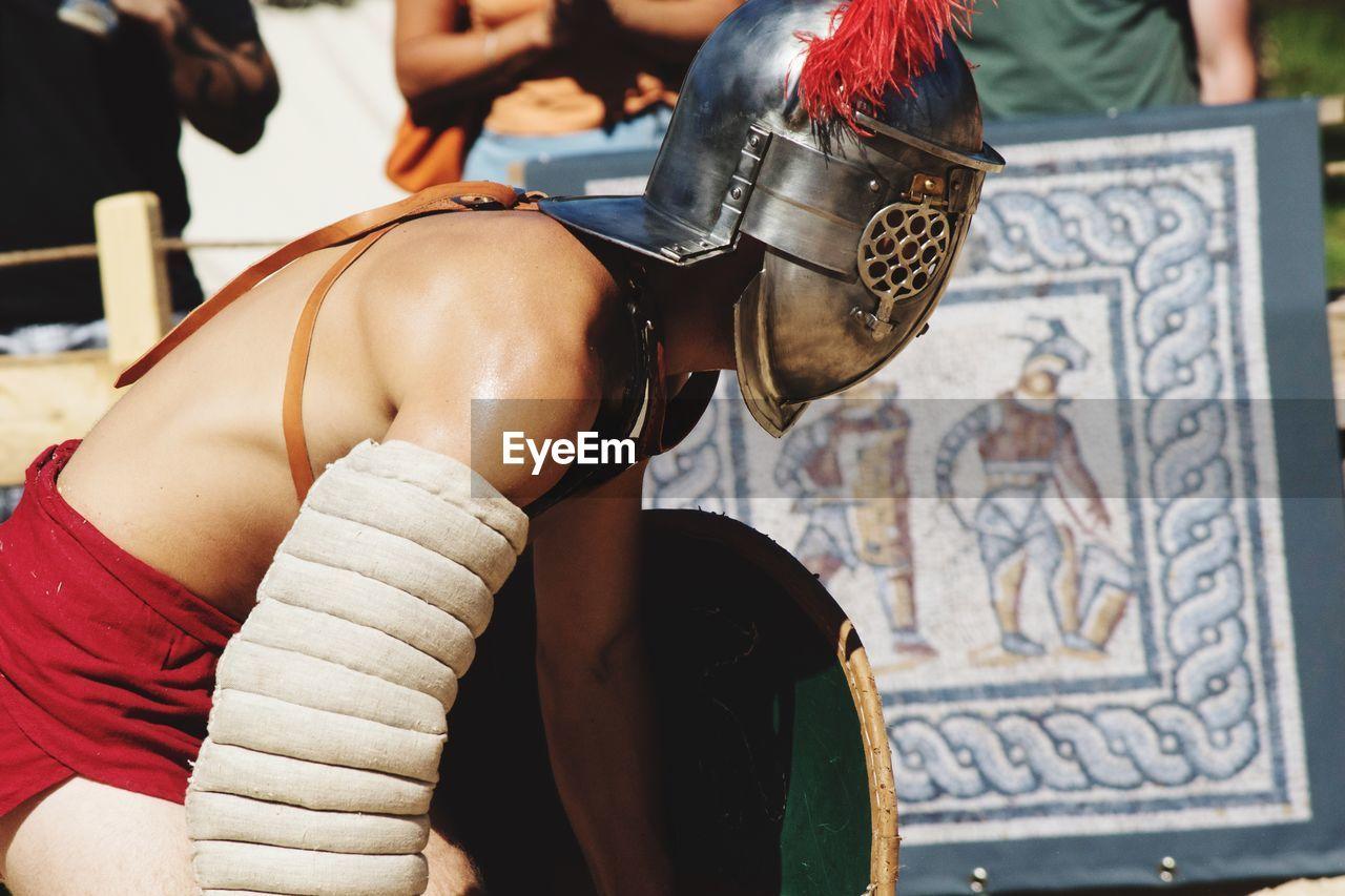 Portrait of man in gladiator costume