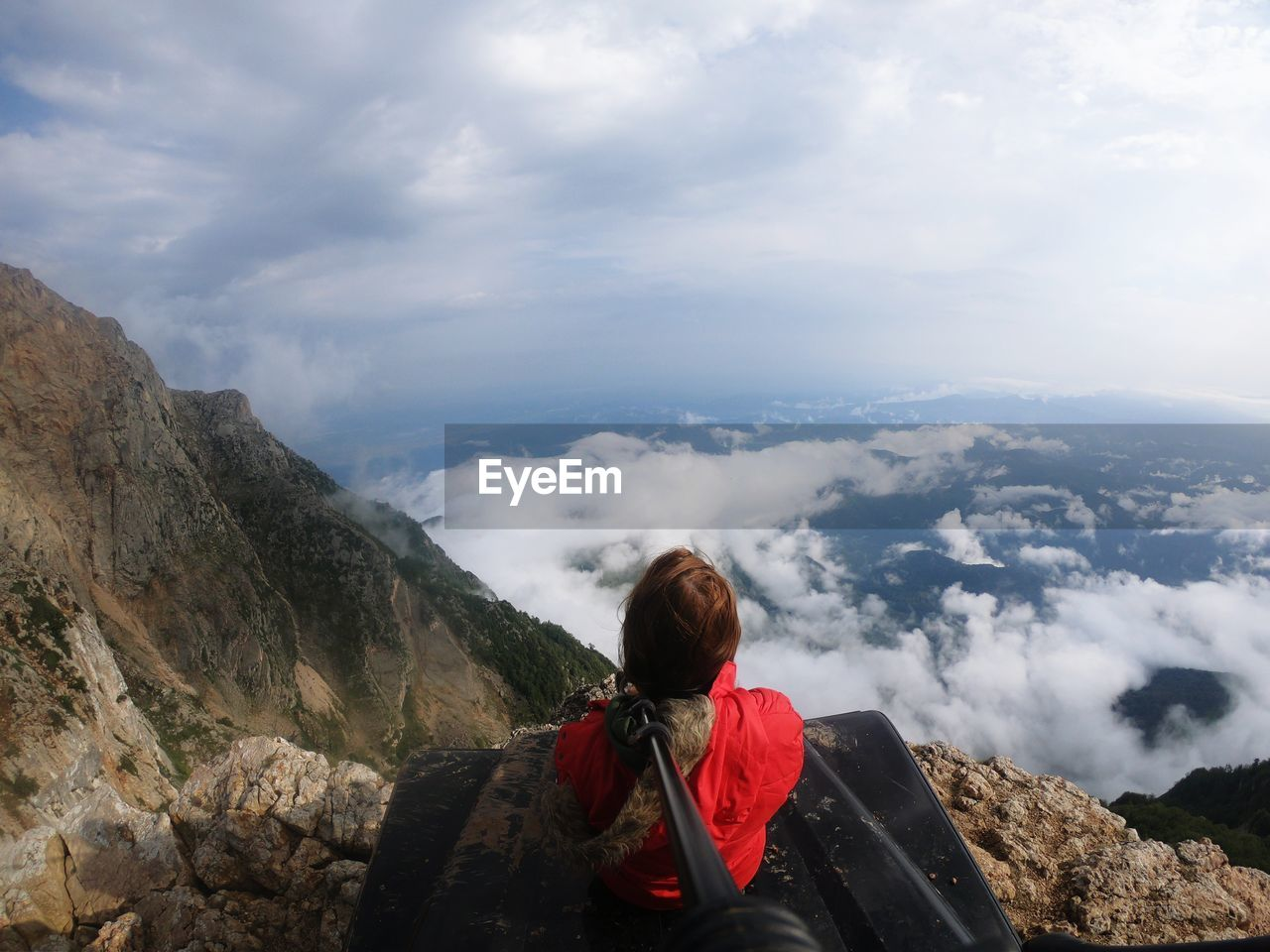 mountain, cloud - sky, real people, adventure, one person, leisure activity, lifestyles, hiking, scenics - nature, beauty in nature, sky, backpack, nature, rear view, vacations, trip, holiday, rock, exploration, mountain range, outdoors, looking at view