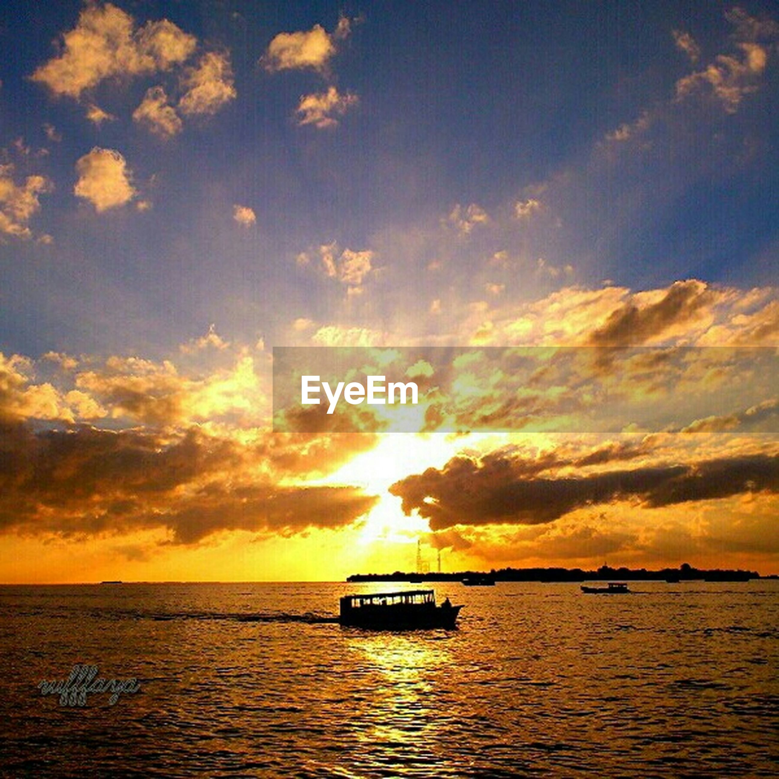 sunset, water, sea, sky, nautical vessel, transportation, orange color, scenics, beauty in nature, mode of transport, waterfront, tranquil scene, tranquility, sun, boat, cloud - sky, horizon over water, idyllic, nature, silhouette