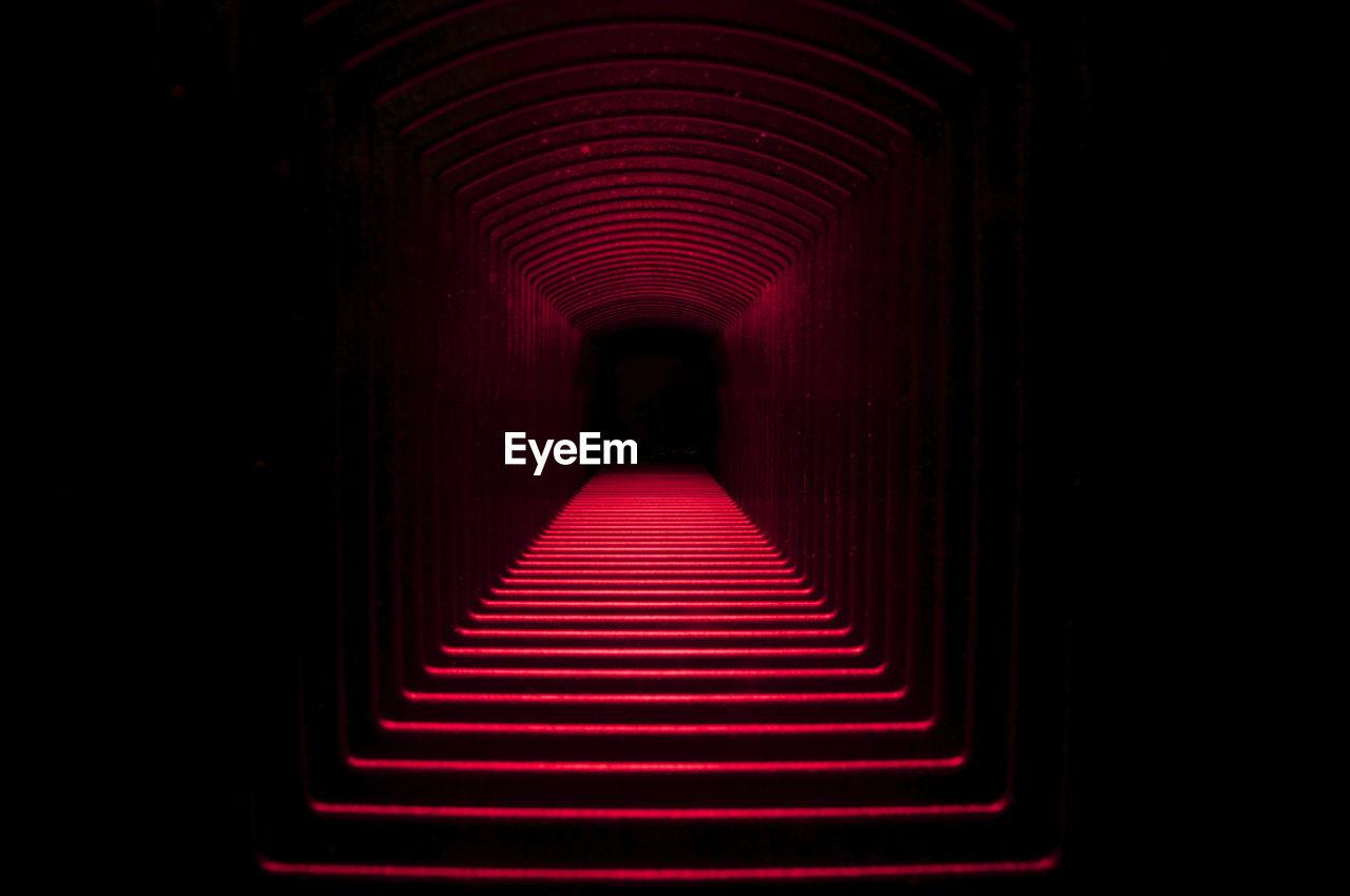 Interior Of Illuminated Red Tunnel