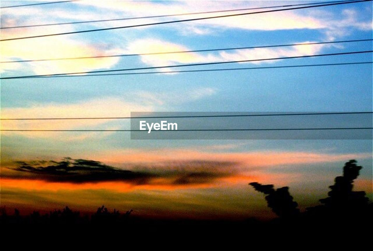 sky, sunset, silhouette, nature, cloud - sky, cable, scenics, no people, beauty in nature, outdoors, landscape, low angle view, electricity pylon, tree, day