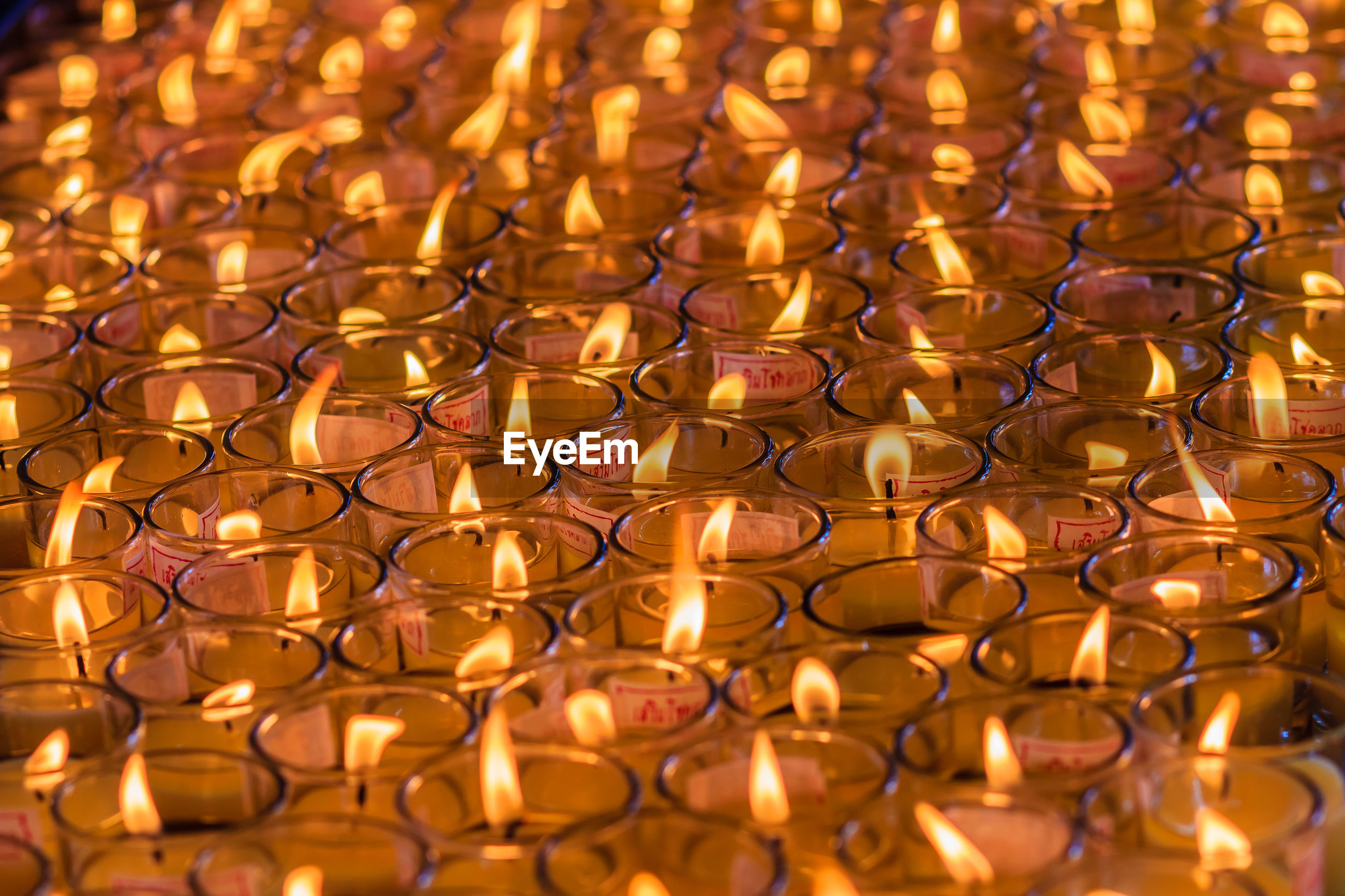 Close-up of illuminated tea lights