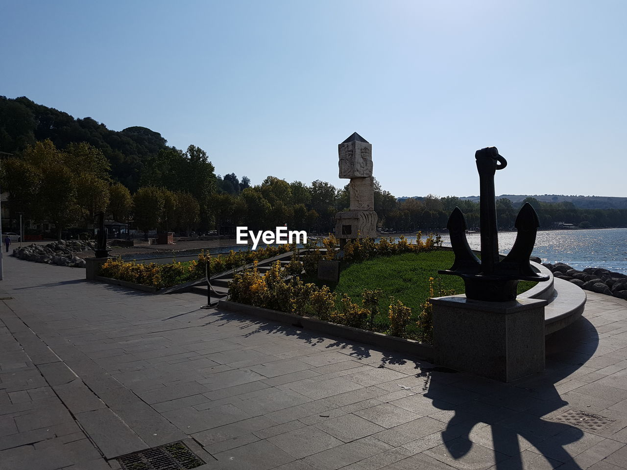 day, outdoors, clear sky, water, built structure, nature, statue, history, tree, no people, architecture, sculpture, sky