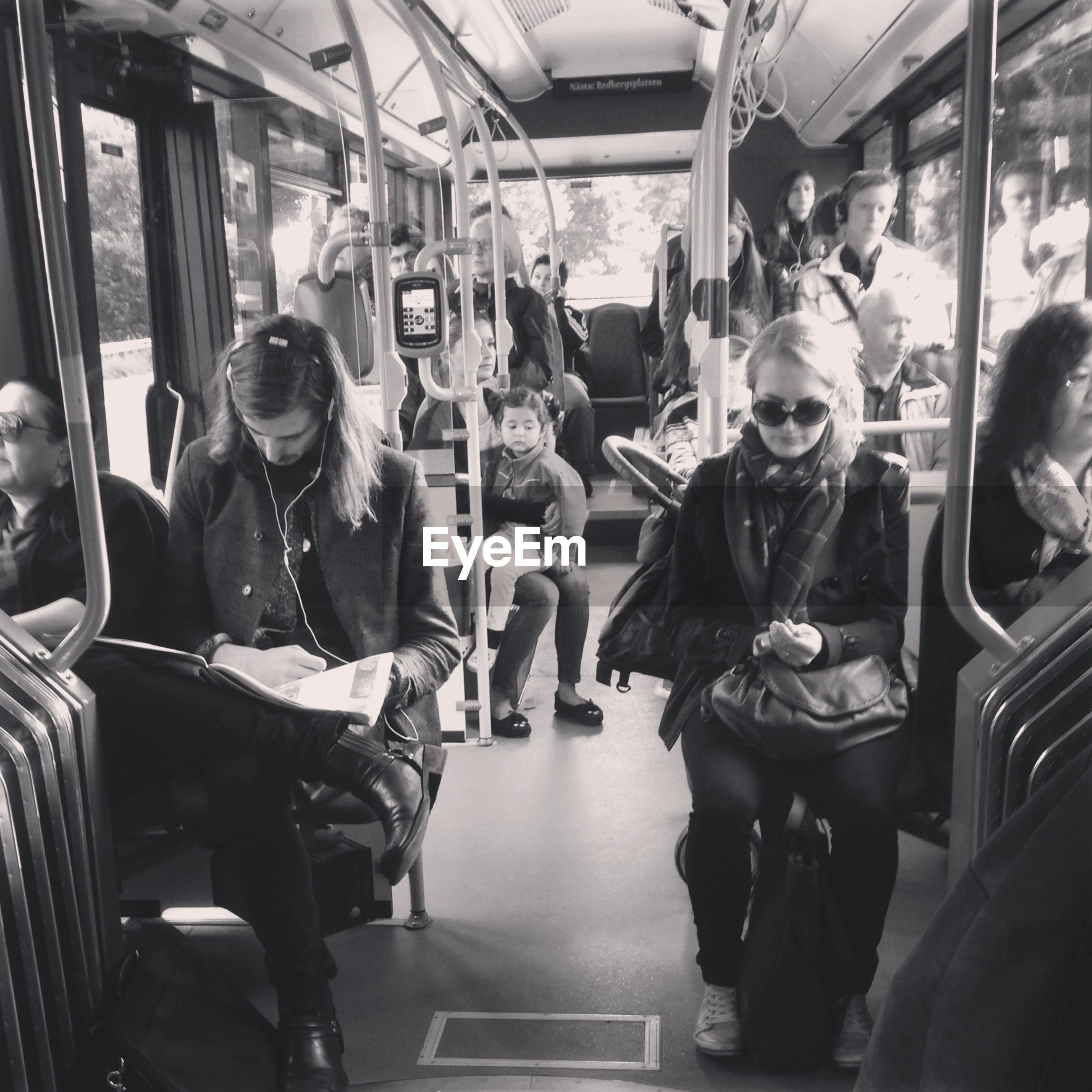 indoors, men, lifestyles, person, large group of people, public transportation, leisure activity, retail, transportation, sitting, shopping, store, casual clothing, passenger, consumerism, incidental people, medium group of people, market, mode of transport