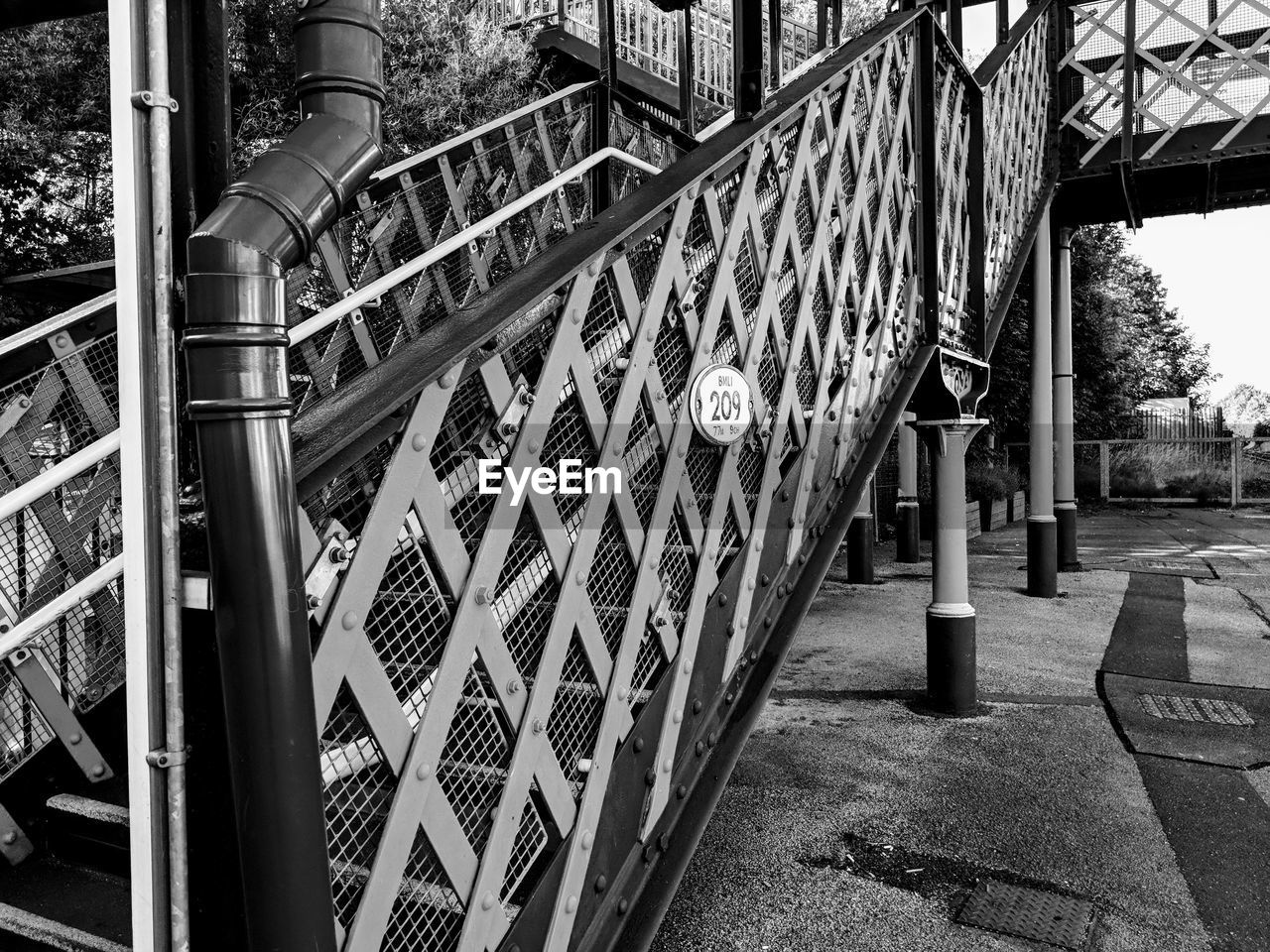 built structure, architecture, metal, no people, building exterior, day, railing, staircase, safety, outdoors, security, pattern, city, nature, architectural column, building, protection, transportation, bridge, connection, wrought iron
