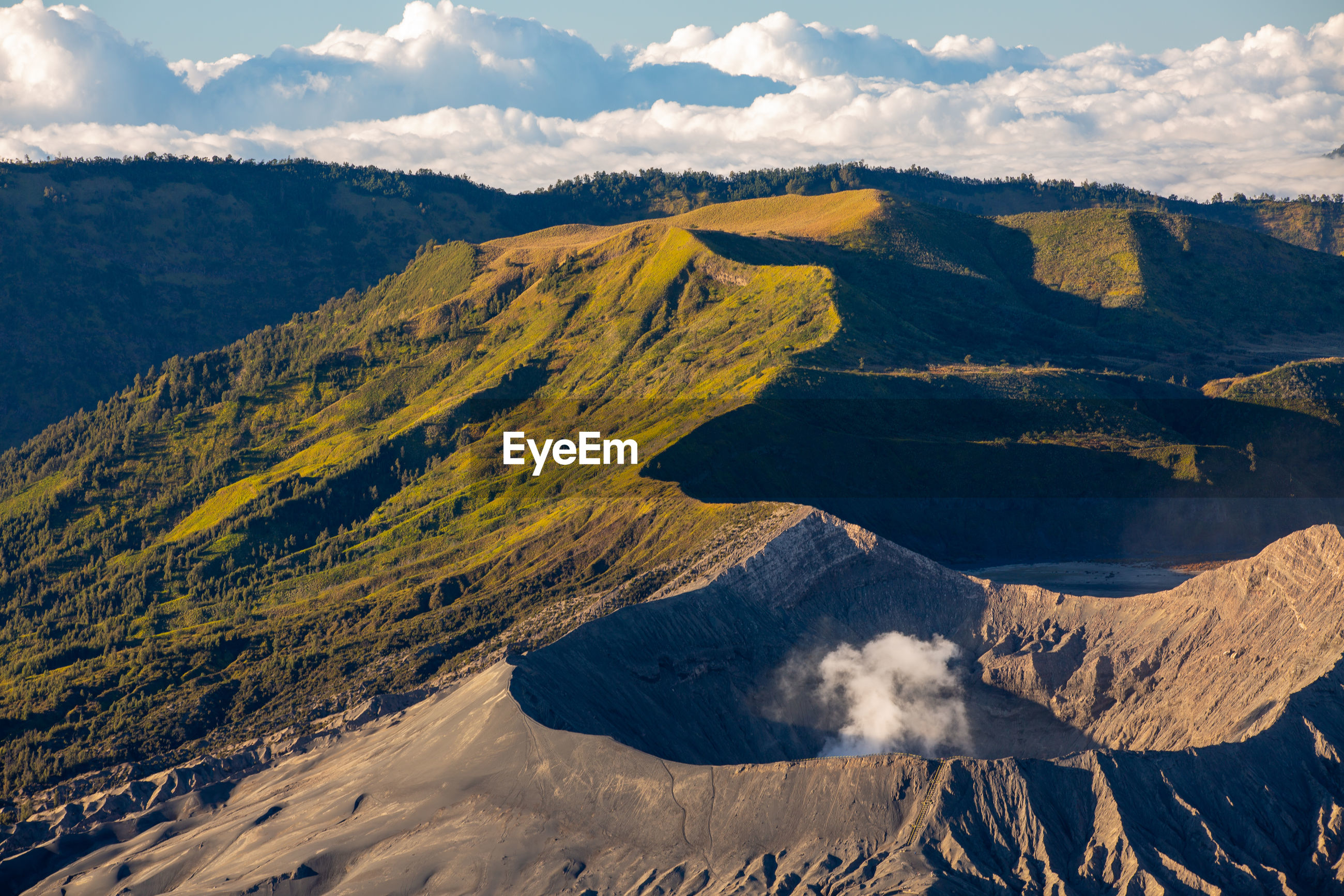 Scenic view of volcanic mountain range against sky