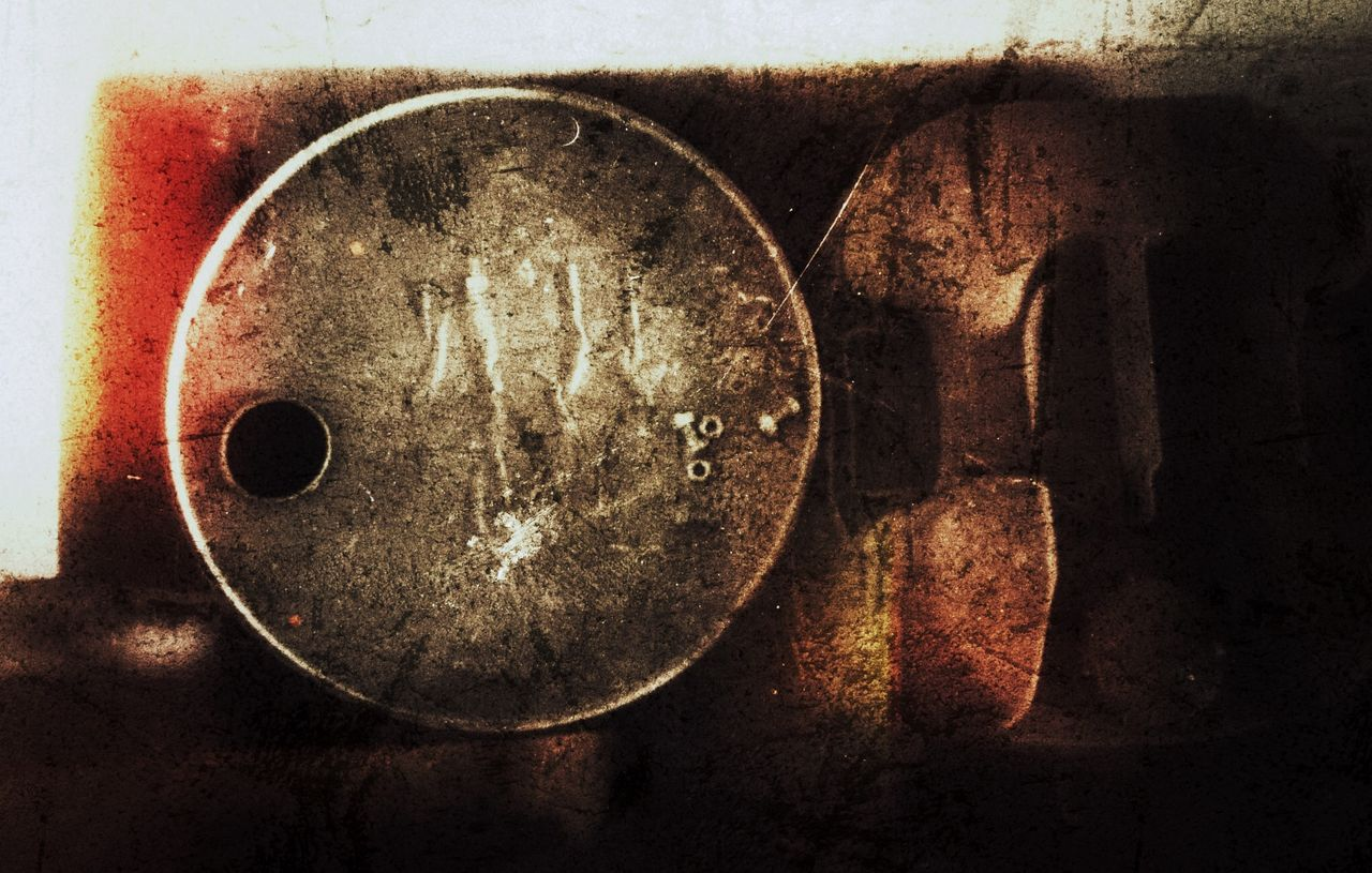 CLOSE-UP OF RUSTY OBJECT