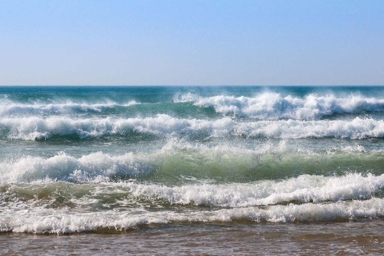 sea, wave, horizon over water, water, motion, horizon, scenics - nature, beauty in nature, sport, aquatic sport, surfing, sky, waterfront, clear sky, day, nature, land, outdoors, power in nature, flowing water
