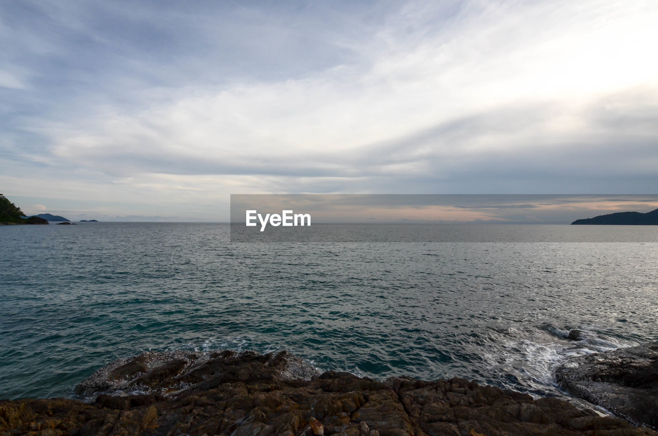 sky, water, sea, cloud - sky, scenics - nature, beauty in nature, tranquility, tranquil scene, rock, nature, horizon, solid, no people, rock - object, horizon over water, beach, land, non-urban scene, sunset, outdoors, rocky coastline
