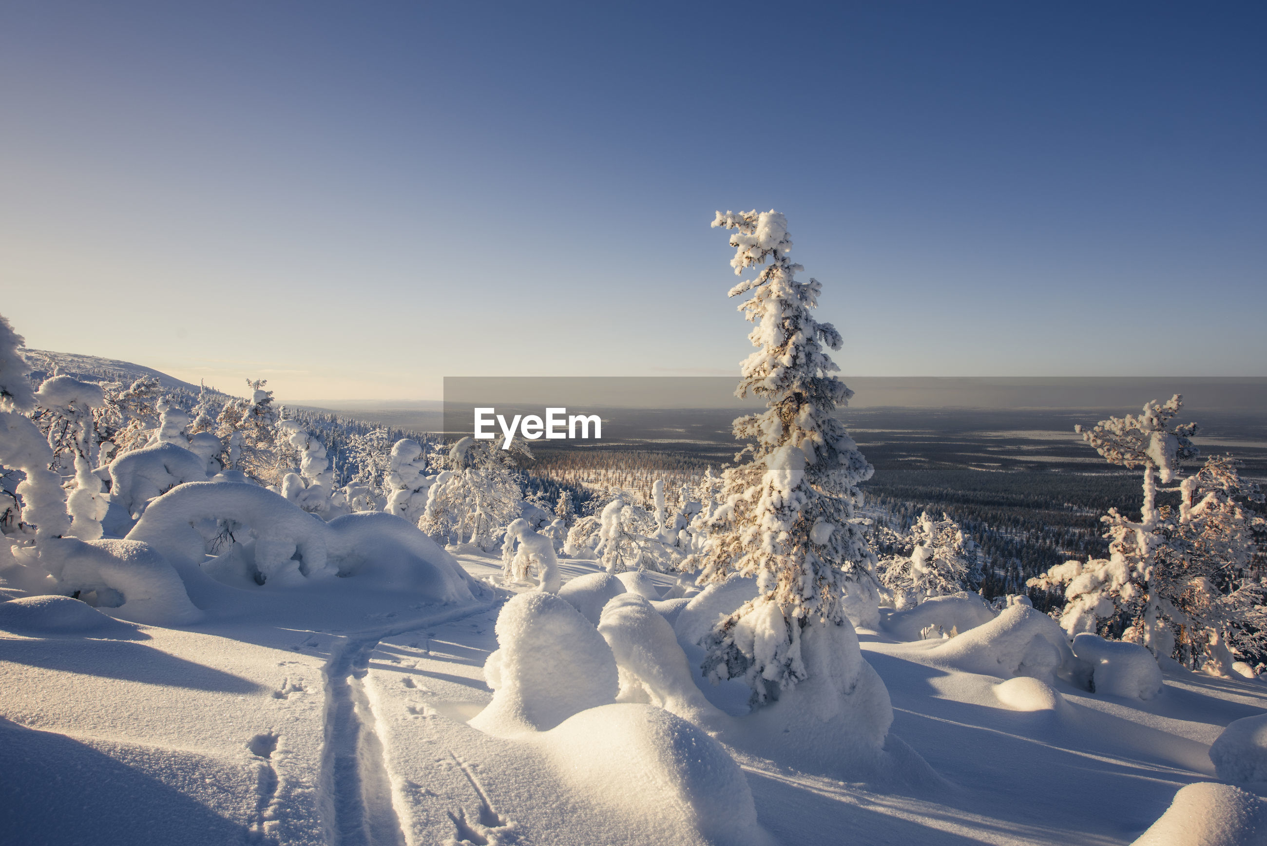 SNOW COVERED LANDSCAPE AGAINST CLEAR SKY DURING WINTER