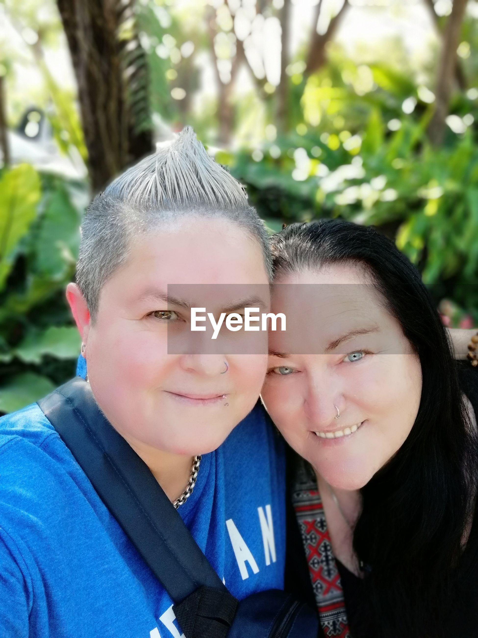 Portrait of smiling lesbian couple outdoors