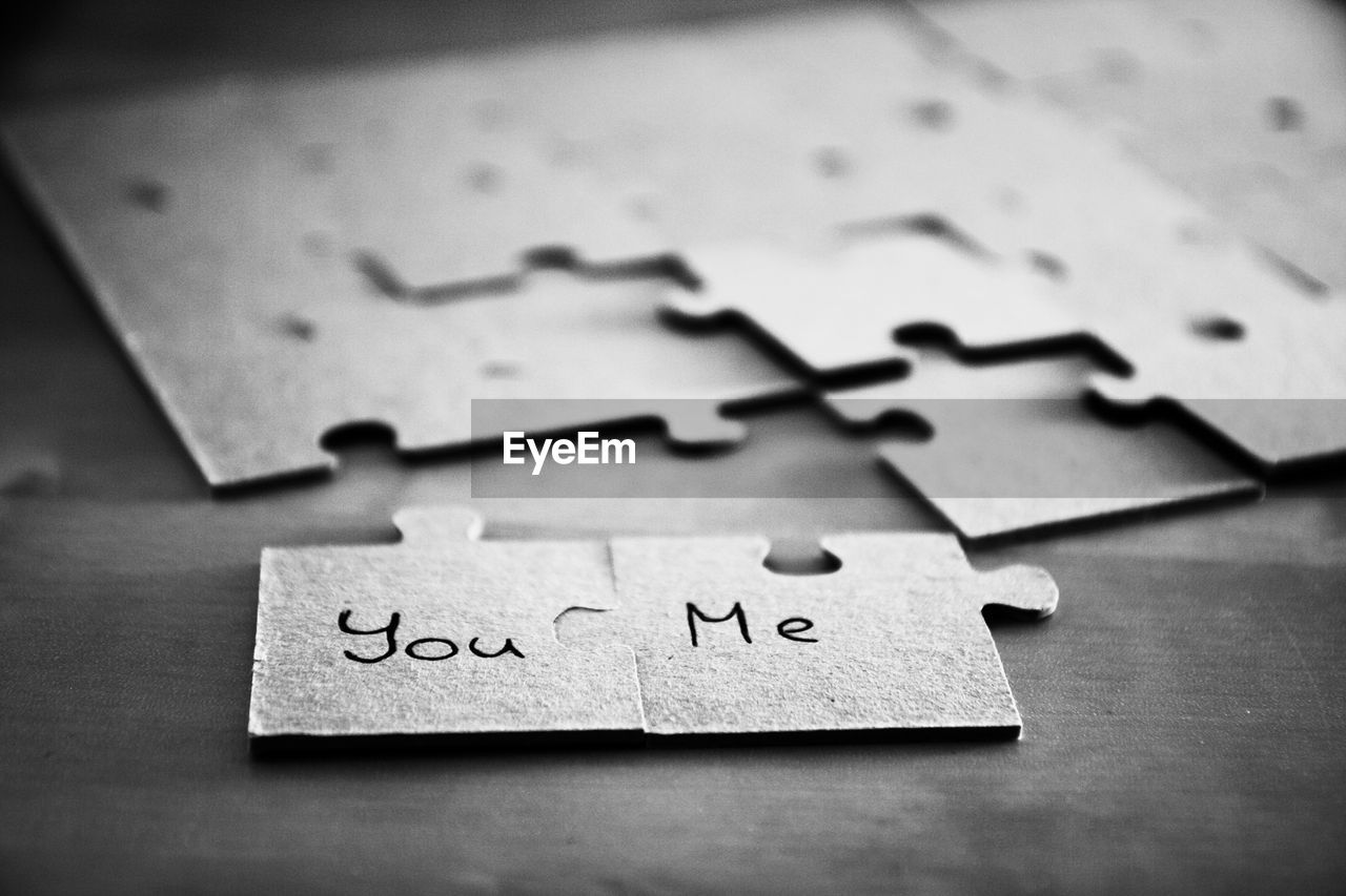Words written on jigsaw puzzle pieces