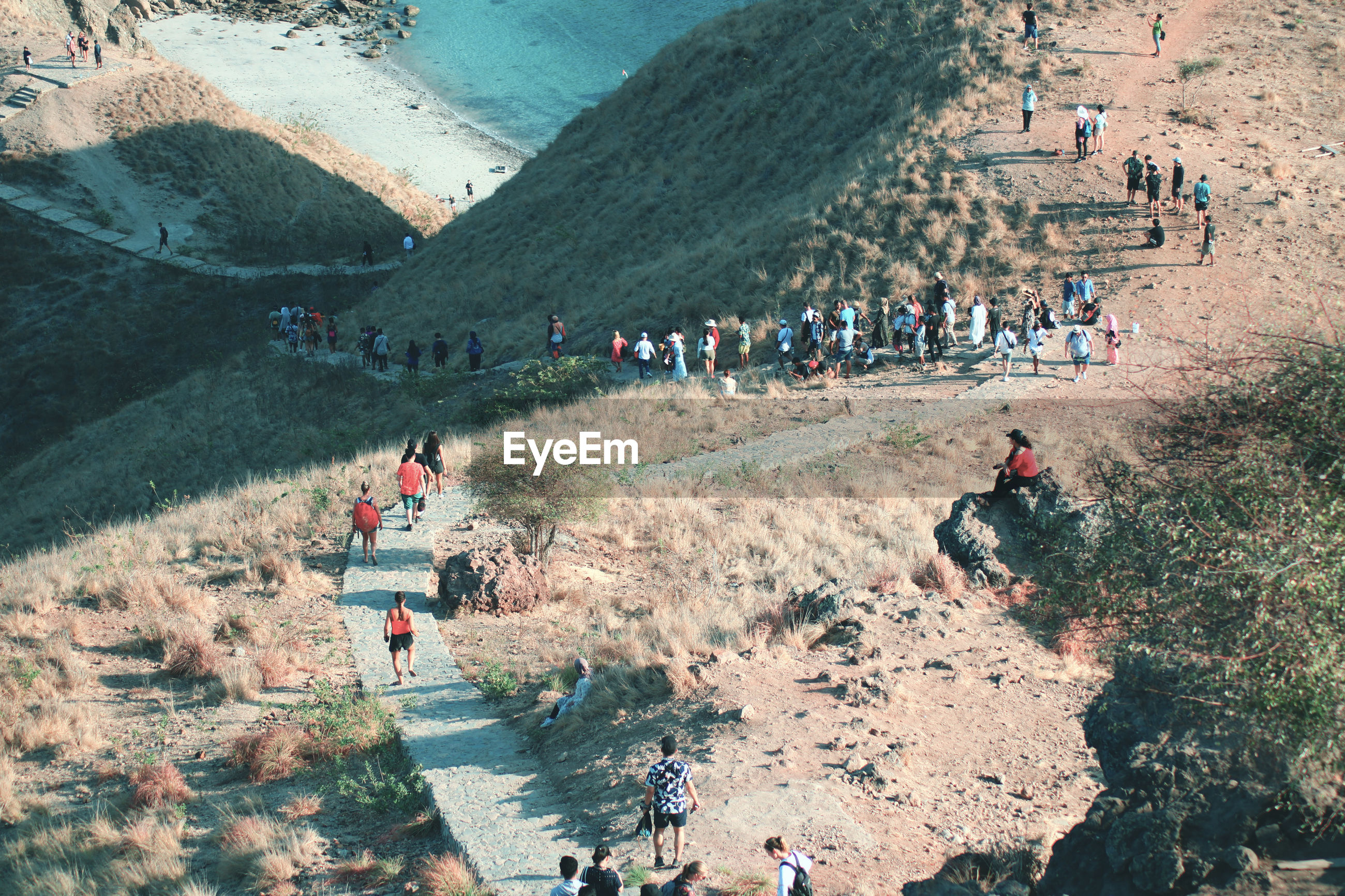High angle view of people on mountain road