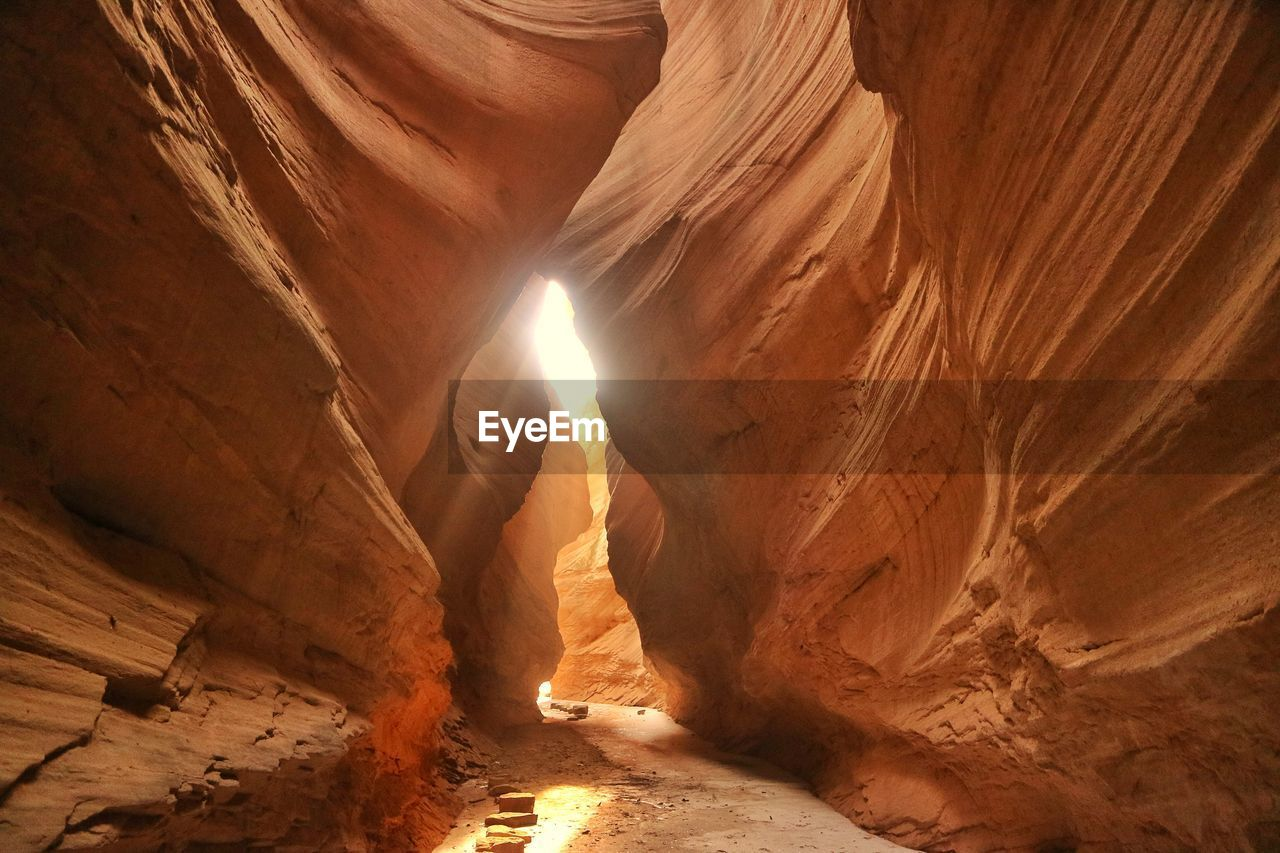 rock, rock formation, rock - object, physical geography, geology, solid, travel destinations, non-urban scene, beauty in nature, travel, nature, scenics - nature, tranquility, tourism, no people, sunlight, eroded, sandstone, brown, tranquil scene, outdoors, climate, arid climate, formation