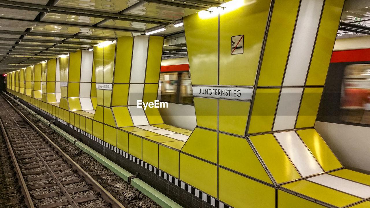 Speeding Blurred Train At Underground Railway Station