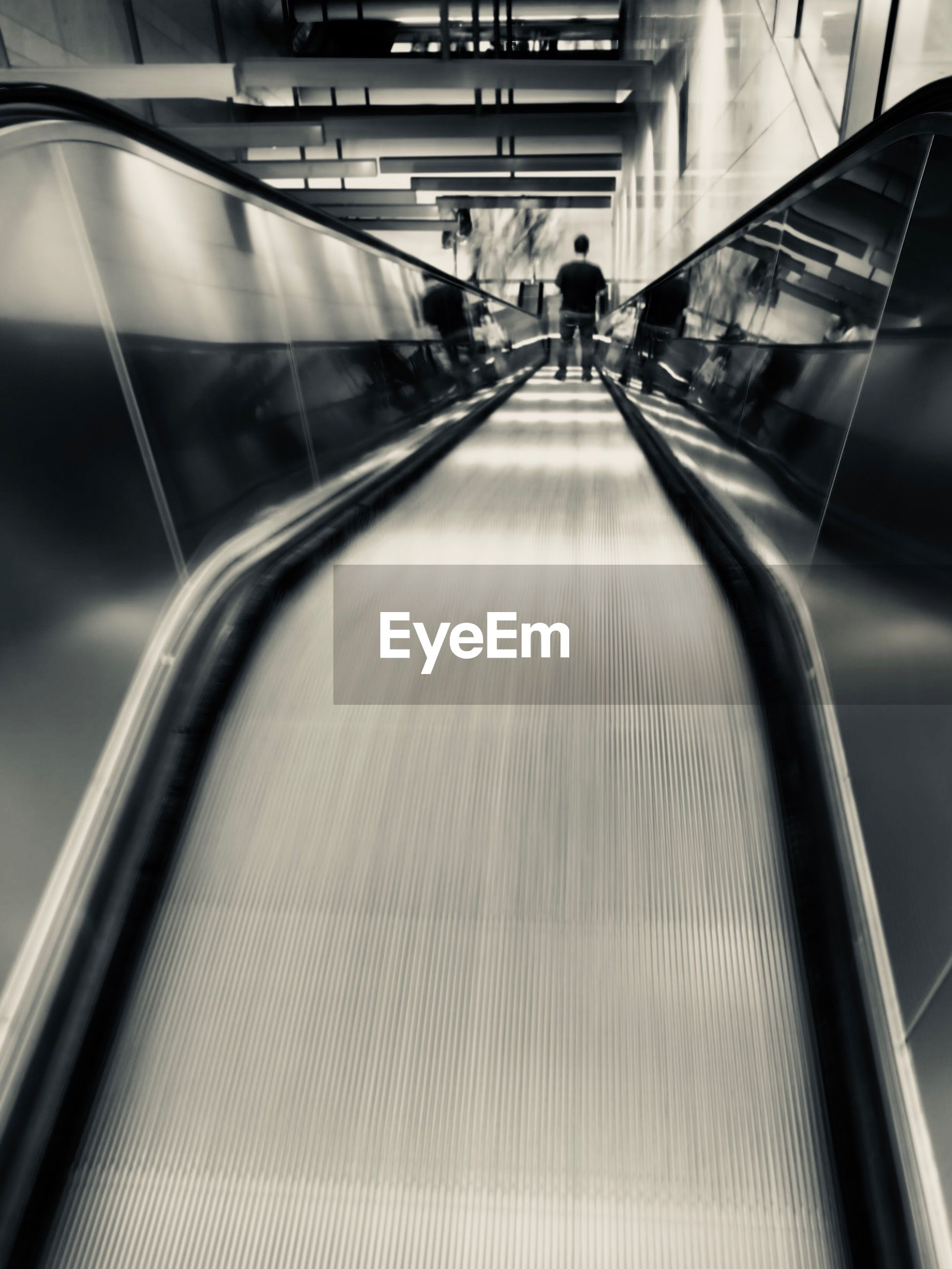 High angle view of man on escalator at railroad station