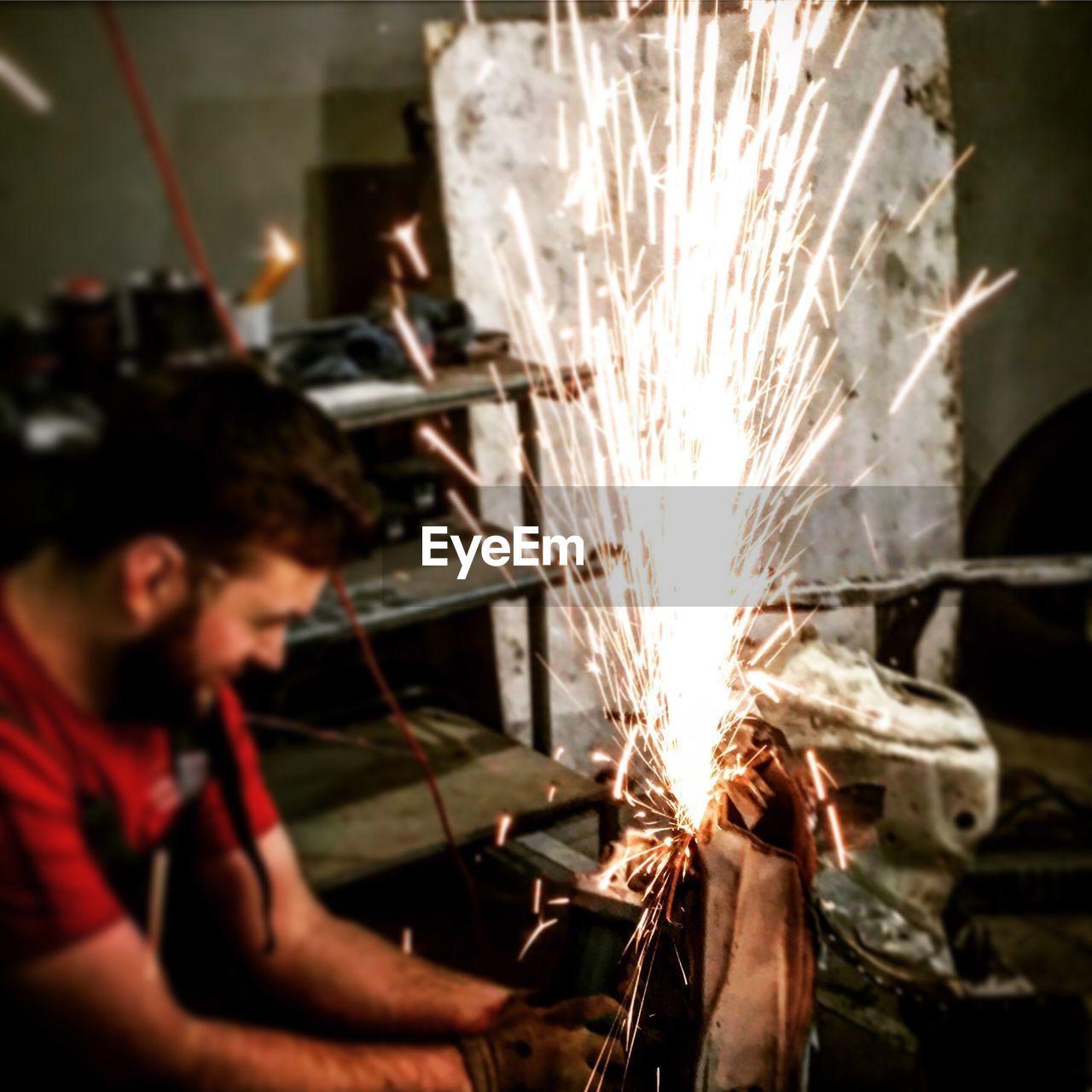 Man working at metal workshop