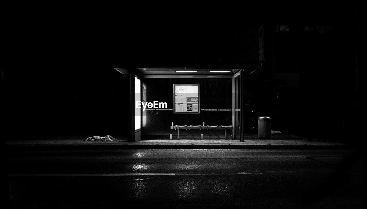 Empty Illuminated Bus Shelter In City At Night