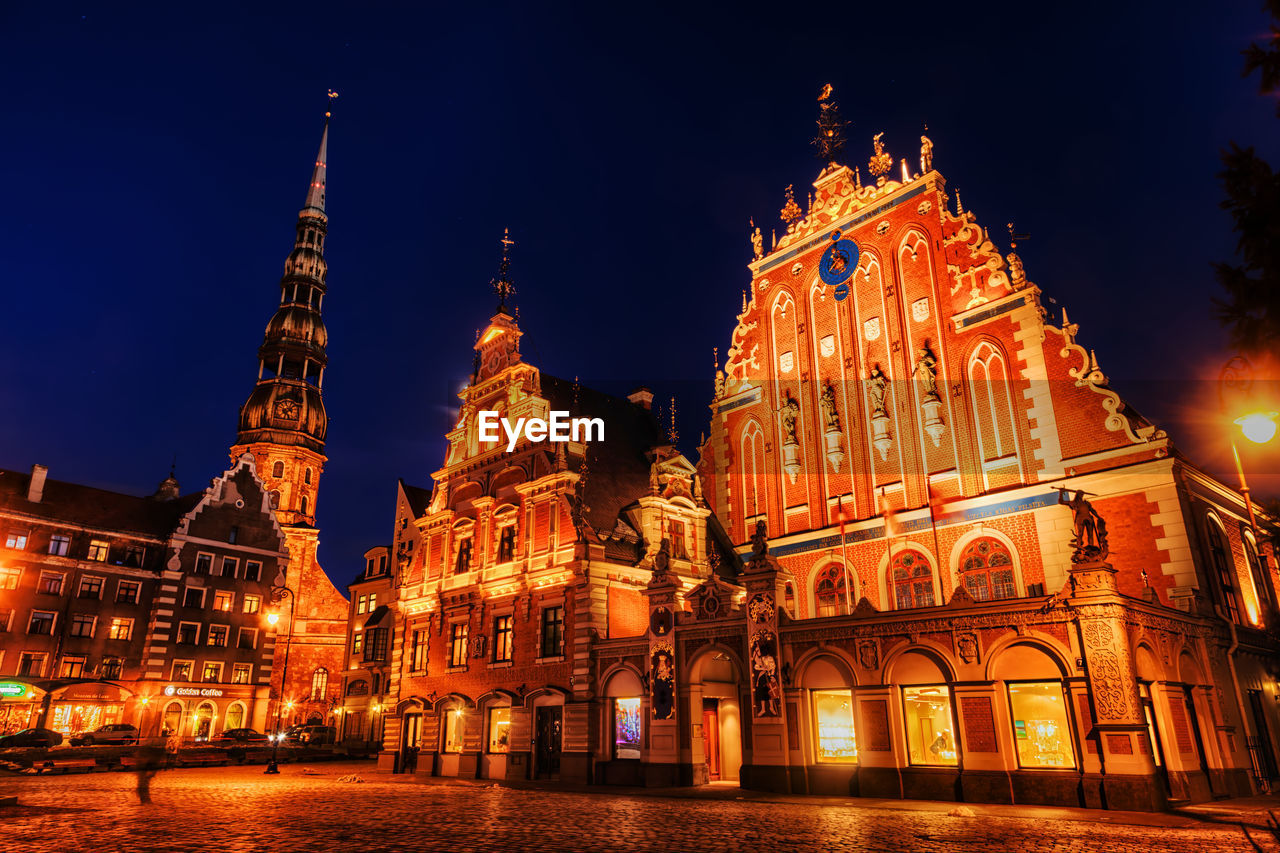 LOW ANGLE VIEW OF ILLUMINATED CATHEDRAL AGAINST SKY