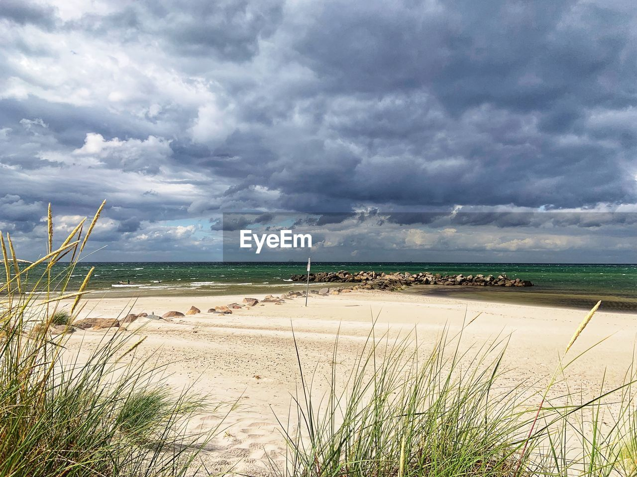 cloud - sky, sky, beauty in nature, land, scenics - nature, plant, grass, tranquil scene, tranquility, beach, water, sand, nature, sea, day, environment, growth, no people, marram grass, outdoors