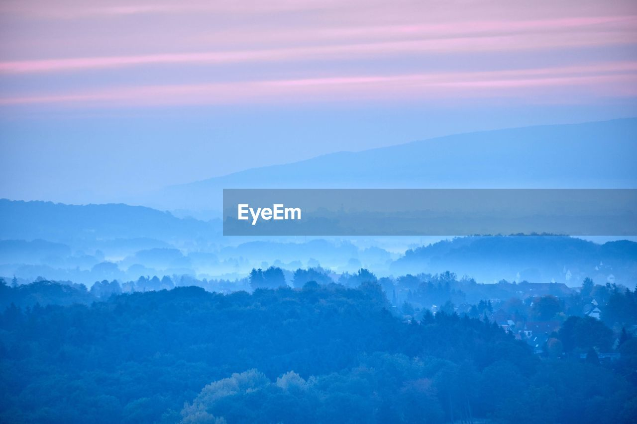 beauty in nature, tranquil scene, scenics - nature, sky, tranquility, idyllic, cloud - sky, no people, environment, sunset, nature, fog, mountain, landscape, outdoors, non-urban scene, majestic, tree, high angle view, hazy