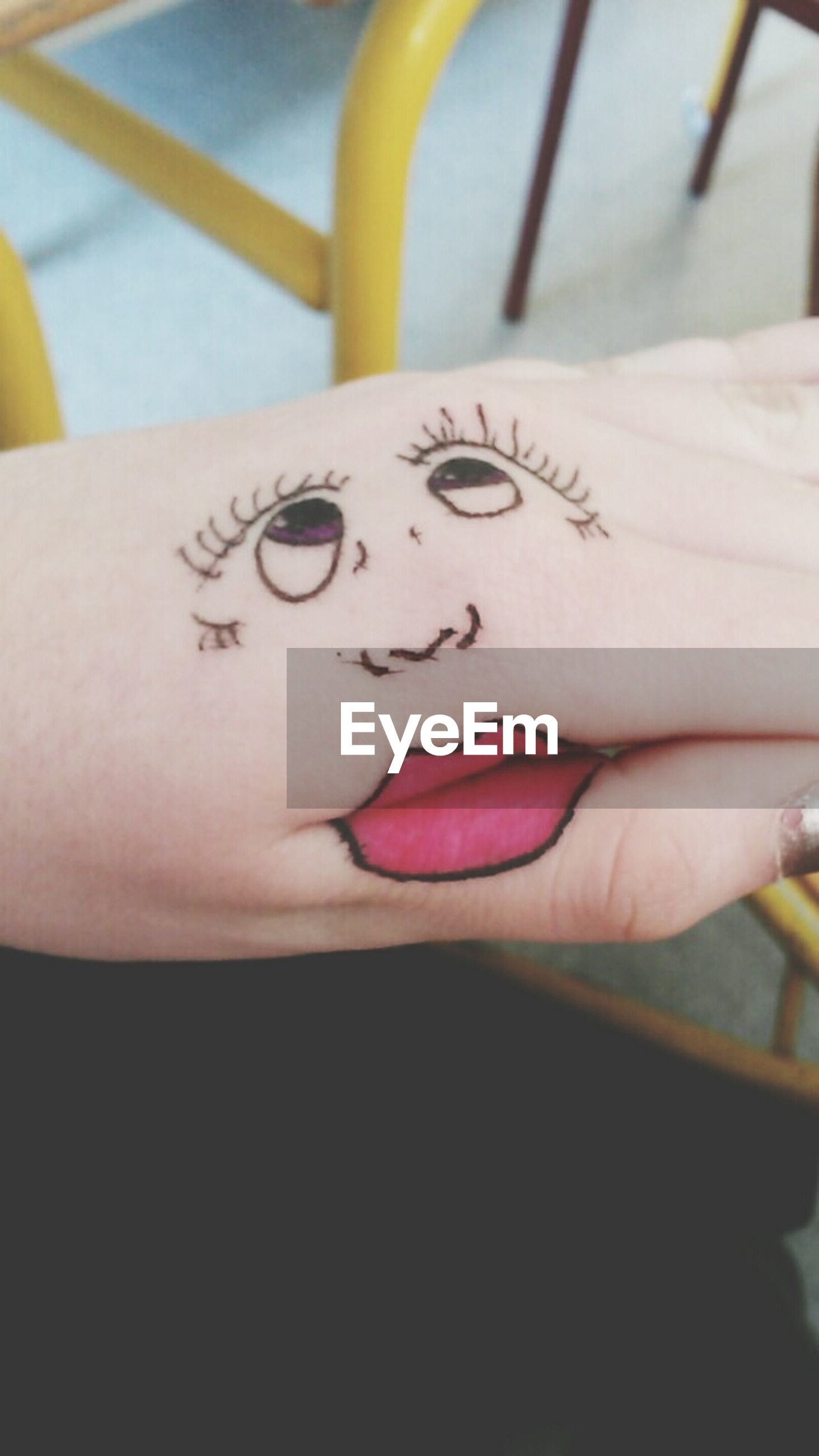 indoors, text, person, western script, close-up, communication, part of, human finger, paper, creativity, focus on foreground, lifestyles, art, cropped, holding, art and craft, tattoo